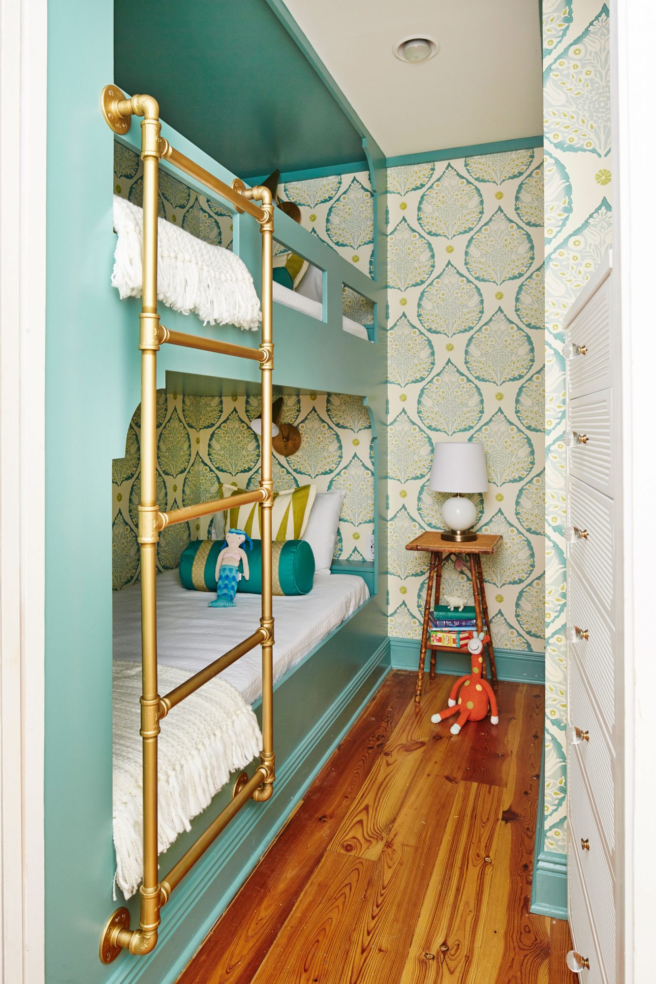 Get the Blues: Composed by Sherwin-Williams                                        In this Rosemary Beach condo, dynamite design transformed a Rosemary Beach condo's weak spot into a kid-friendly win. Coastal Living Style Director Lindsey Ellis Beatty outfitted the teeny, seven-feet-by-six-feet space with custom millwork fit to the room's dimensions, then painted and lacquered the bunks in a zippy aqua to give the room a fun, hideaway feel.
