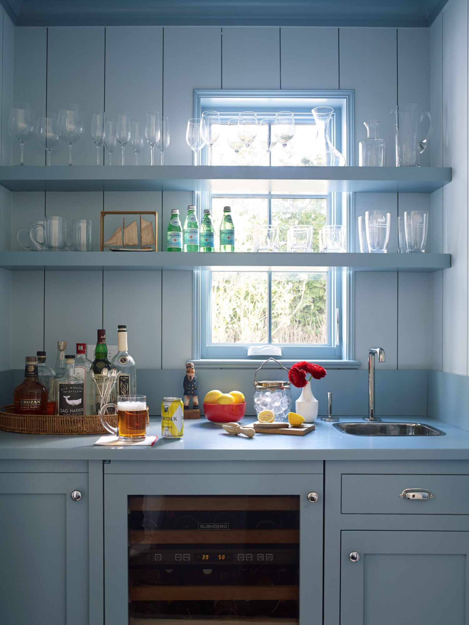 "Get the Blues: Wall paneling in Yarmouth Blue and cabinetry and shelving in Jamestown Blue, both by Benjamin Moore                                       Transform your home's pass-through spaces into linger-worthy stops by painting them unexpected hues. The milky blue on the shelves and cabinets of this built-in wet bar, plus the powder blue-painted shiplap, elevate this hallway alcove from a practical service area to a ""little jewel of a space to be in,"" notes architect Bill Beeton."