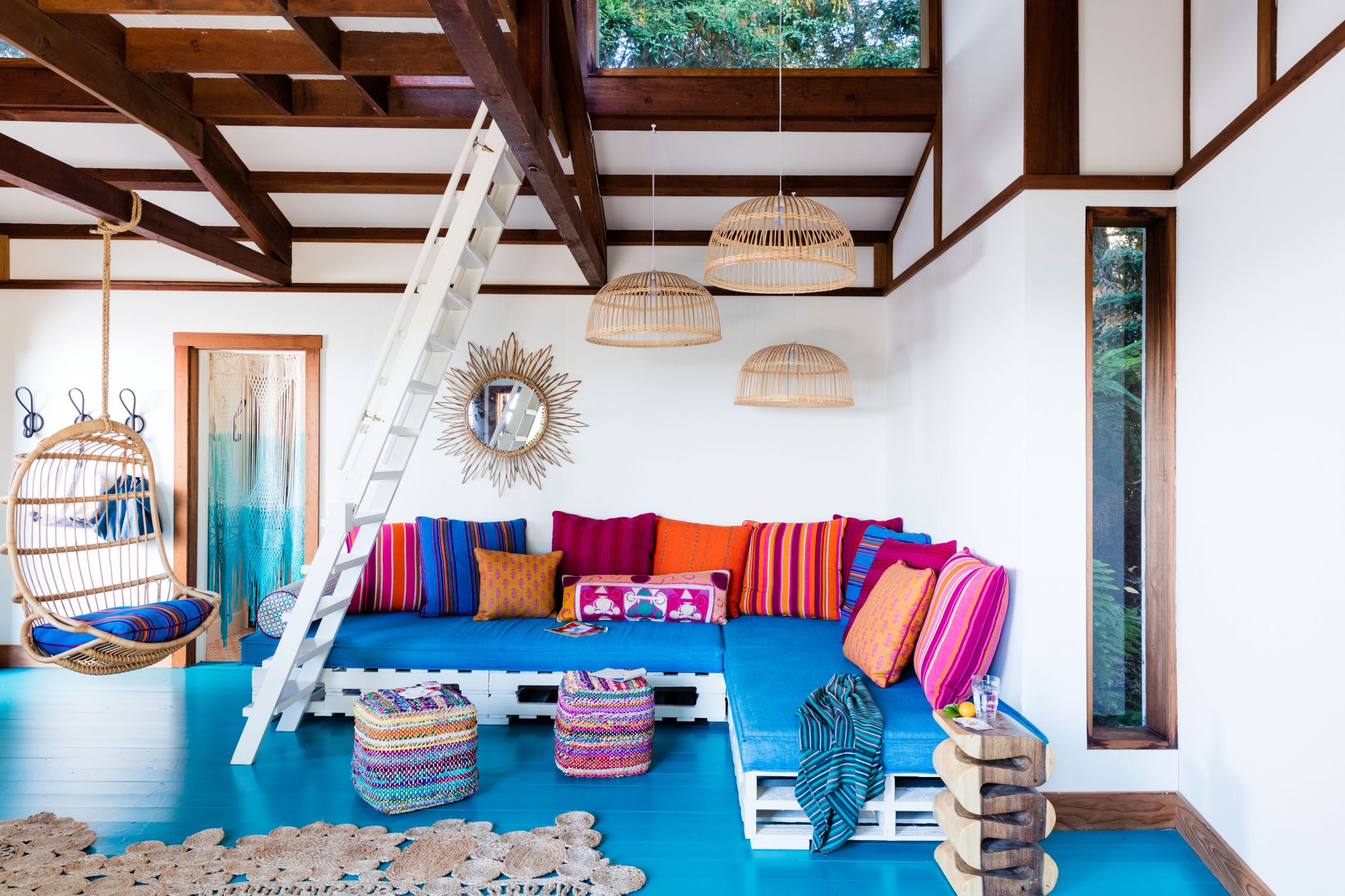 Get the Blues: Venezuelan Sea by Benjamin Moore                                       Give brilliant blues the floor … literally. In this Stinson Beach, California, rancher, which once belonged to Jerry Garcia of the Grateful Dead, designer Allison Bloom transformed the former recording studio into a want-to-hang-out-there-all-day guesthouse and lounge. Jewel-toned pillows wrapped in vintage Indian silks and linens and a shipping-pallet sectional give the room an extra jolt of groovy, throwback vibes.