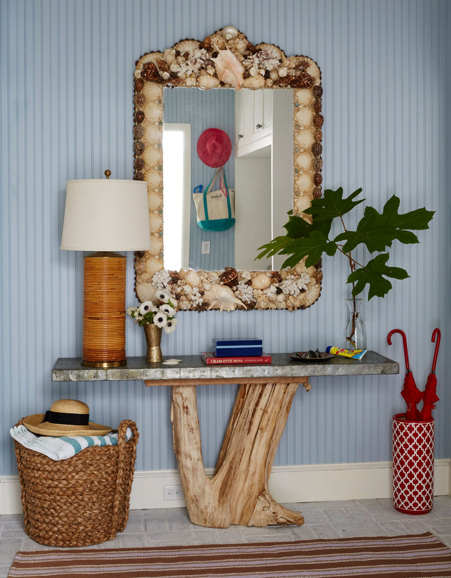 Get the Blues: Nantucket Fog by Benjamin Moore                                       Wall paneling painted a muted gray-blue grounds this Sea Island, Georgia, mudroom in a laid-back, kick-off-your-shoes feel. The soft hue also offers a subtle backdrop for the room's eye-catching organic pieces, like the vintage shell-encrusted mirror and the driftwood-inspired console.