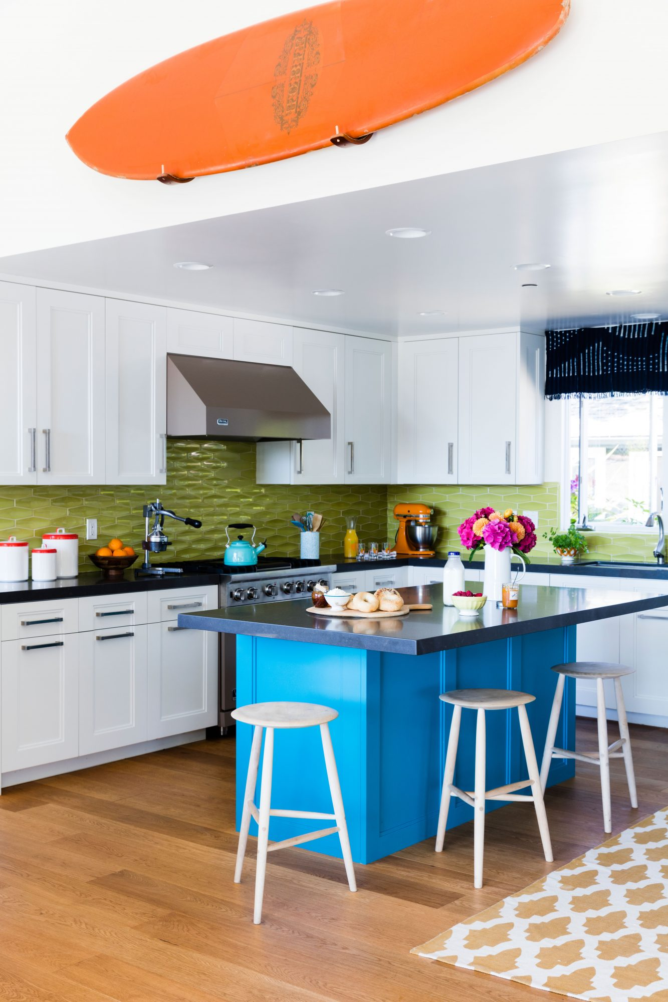 Get the Blues: Pacific Palisades by Benjamin Moore                                       Designer Allison Bloom cooked up a razzle-dazzle palette for this funky Stinson Beach, California, kitchen. A zingy lime tile backsplash sets the freewheeling tone, while an island doused in a vibrant cerulean points to the Pacific Ocean that's just steps from the house. Beechwood stools and warm wooden floors ground the wild colors to keep the mood mellow.