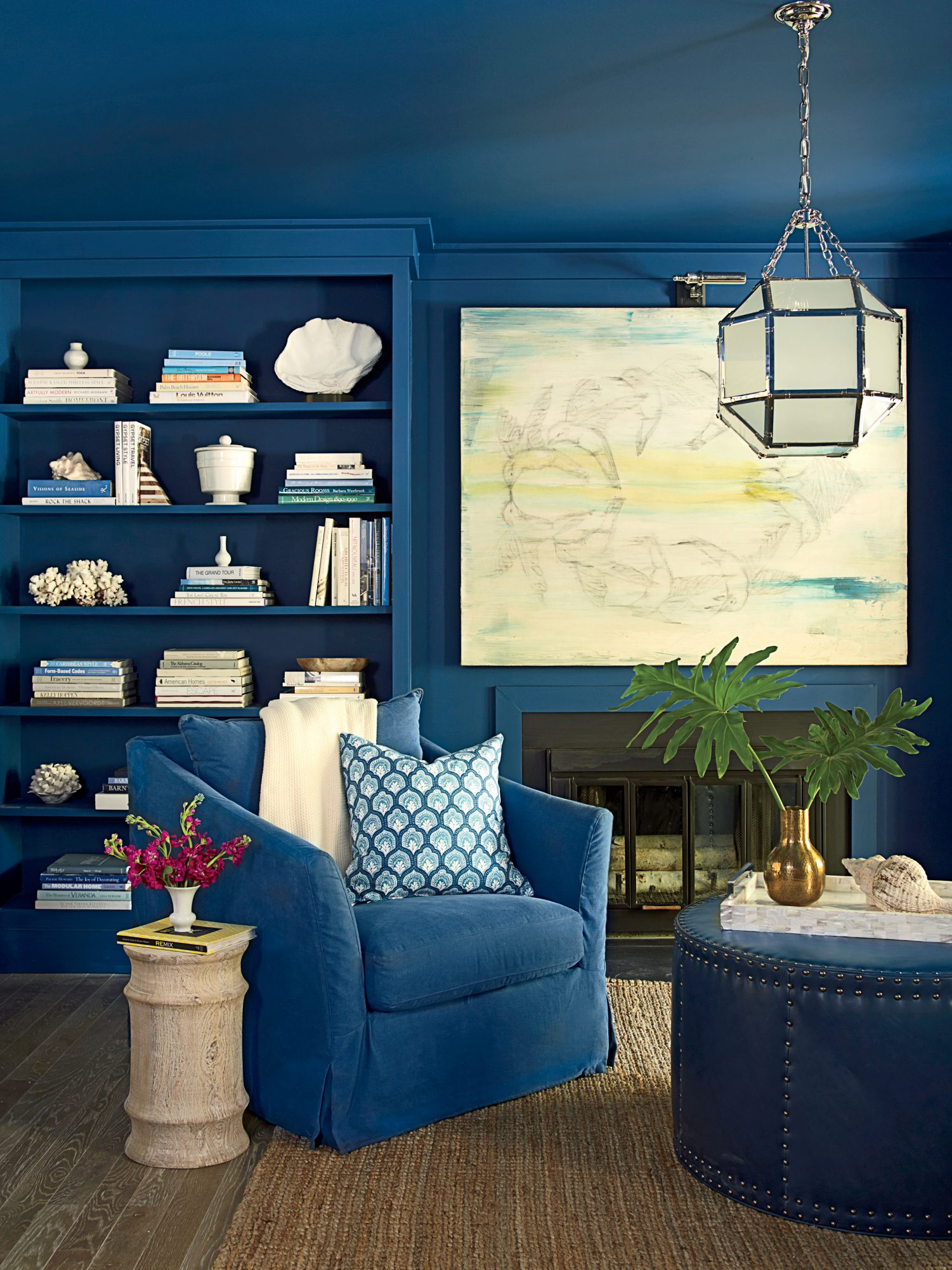 Get the Blues: Slate Teal by Benjamin Moore                                       To make this Florida cottage's teeny family room live larger, designers Mark and Paige Schnell washed the entire den, from trim to ceiling, in a rich marine blue. White artwork and accessories, plus a polished nickel pendant, brighten the deep sapphire hue and give the small space high-impact dimension.