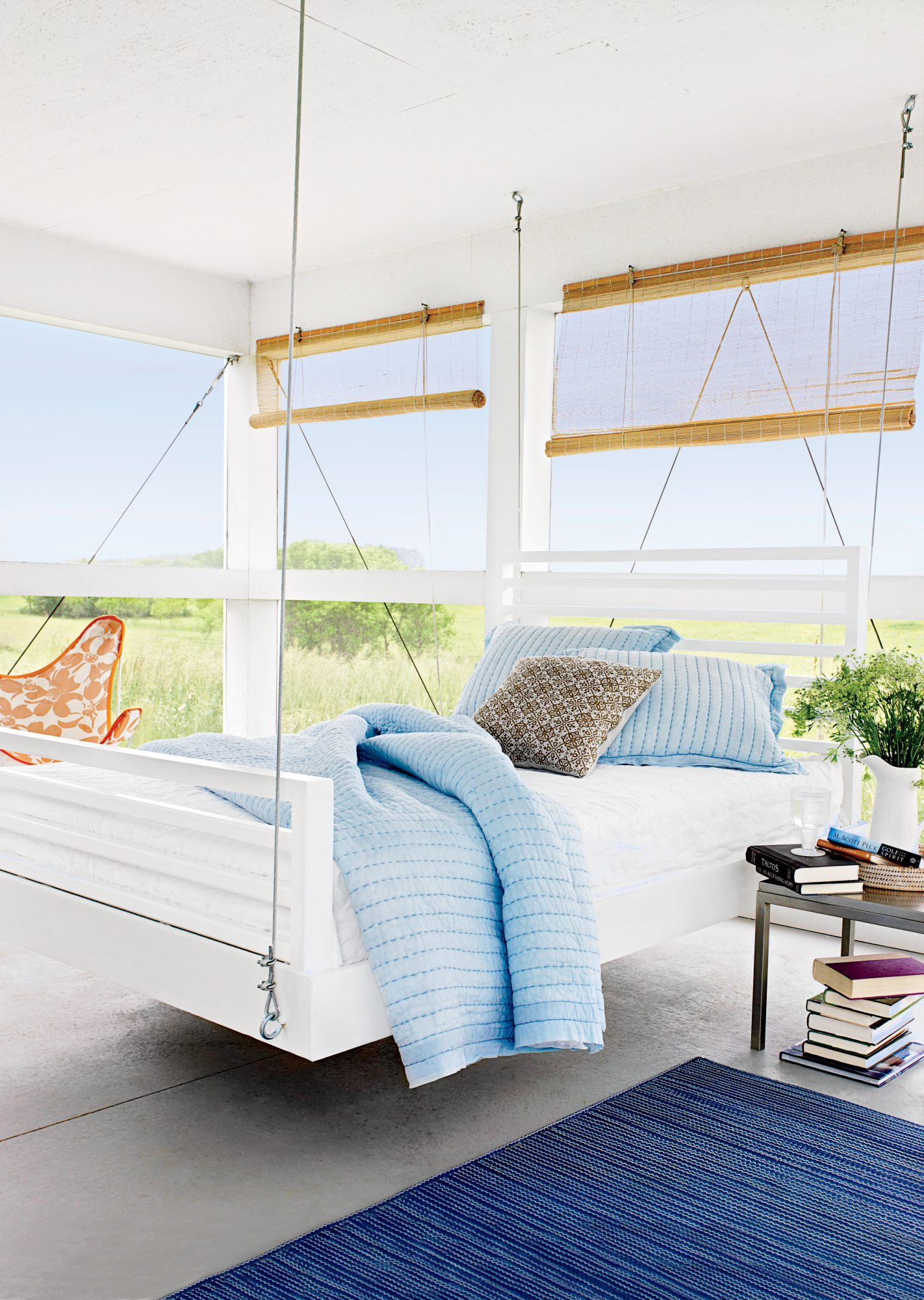This open-air retreat may just be the definition of breezy. The large white bed is suspended from the ceiling with steel cables for a sleek look, but you can use marine-grade rope or chains for an equally sturdy and good-looking result. Fuss-free bamboo b