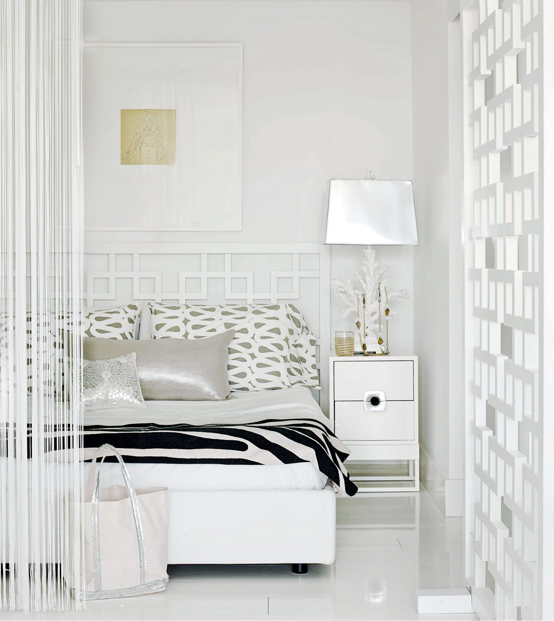 Vibrant silver-sequined pillows and a fun, zebra-print blanket nod to the glamorous Miami lifestyle just outside.