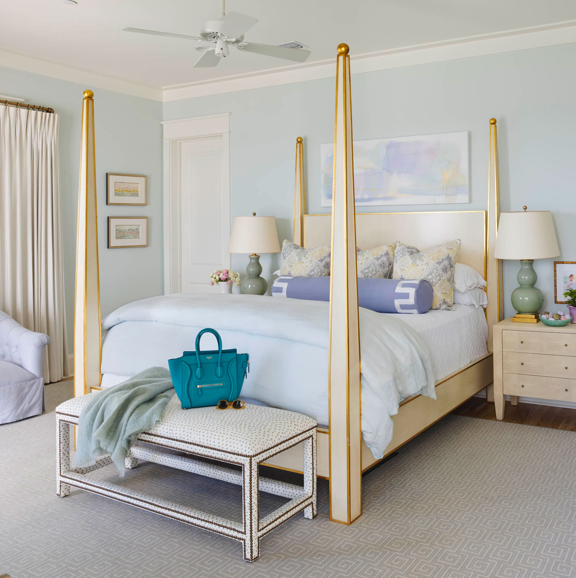 "Get the Blues: Window Pane by Sherwin-Williams                                       All the color inspiration homeowner Elizabeth Mazyck and designer Erika Powell needed for the walls of this dreamy master bedroom came from the home's quiet Inlet Beach, Florida, locale. ""My favorite time of day here is sunset, and so often, it appears in sea glass colors – lavender, sea foam, periwinkle,"" says Mazyck. She and Powell pulled those hues into the master bedroom for a palette that's as ethereal and peaceful as the stretch of sand the house overlooks."
