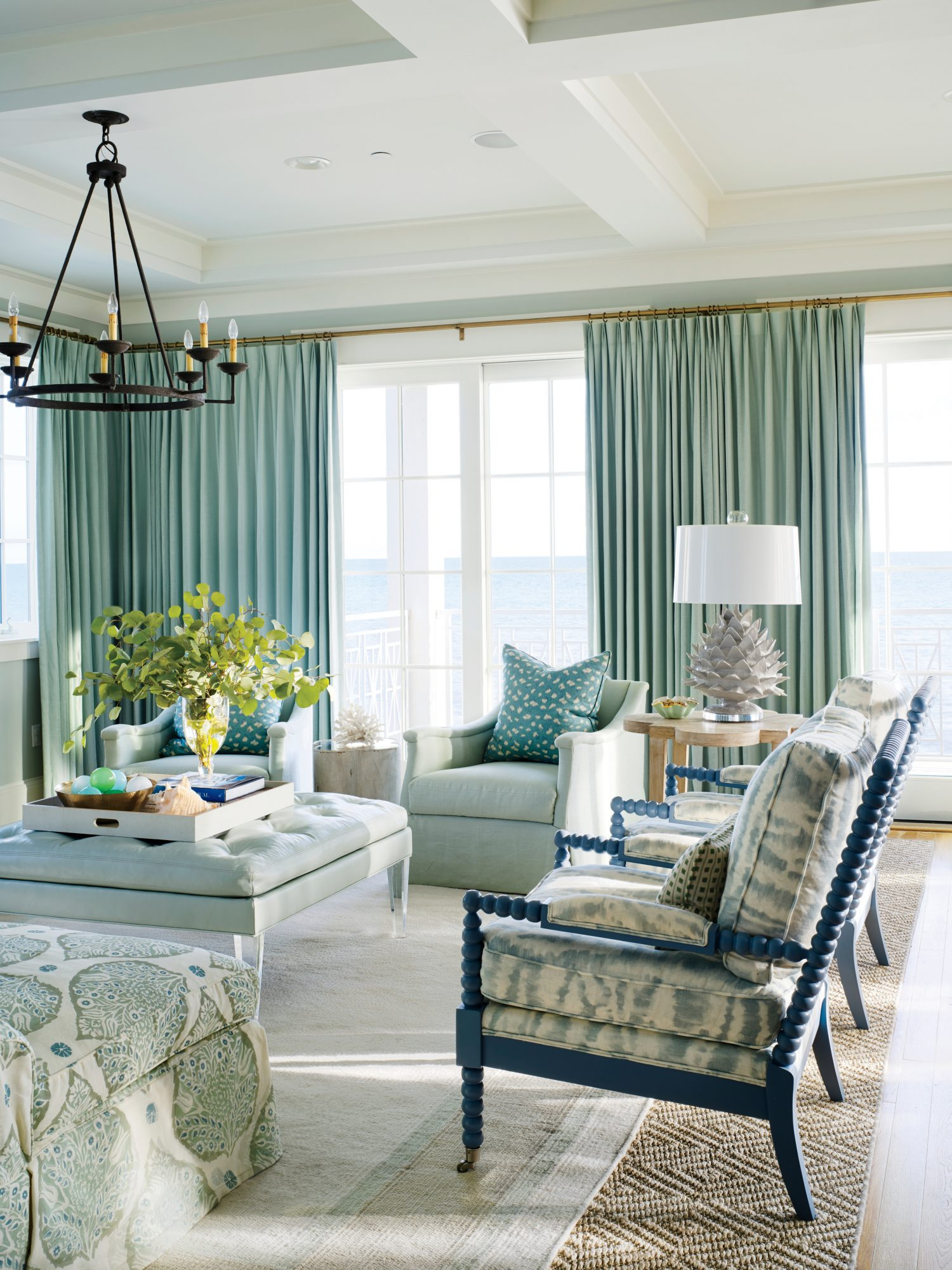 """The views of the Gulf are spectacular here, and the water always seems to be clear,"" says Powell, who went for frosty blue draperies at Elizabeth's suggestion. ""I usually opt for lighter, ivory window treatments, but this blue really draws your eye out t"