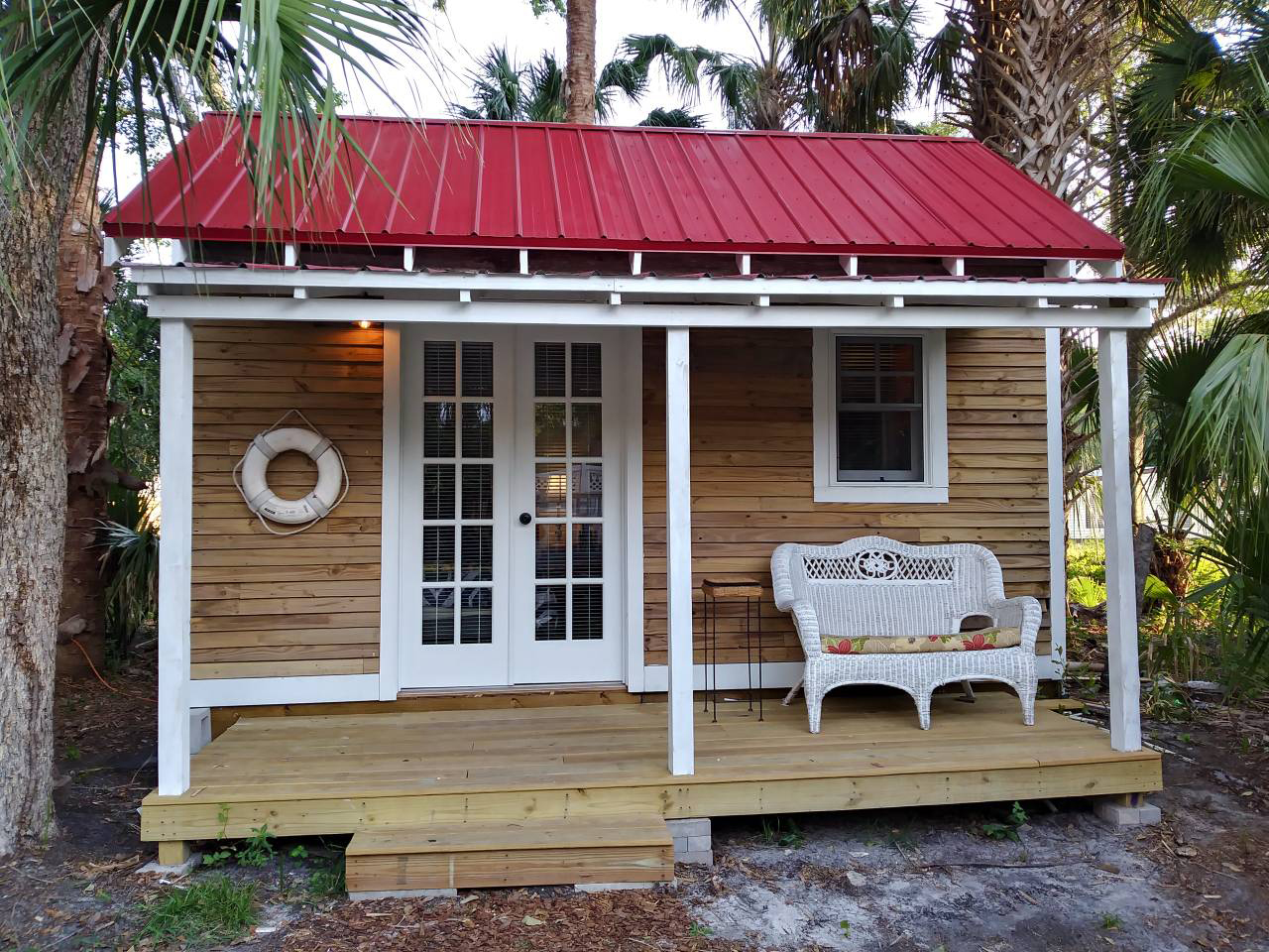 In this salty tiny house, vacation comfort meets St. Augustine's signature seafaring style. The small lodging—with a hot tub, an outdoor shower, and a patio—is just 10 minutes from the nearest beach and from St. Augustine's vibrant Historic Downtown.