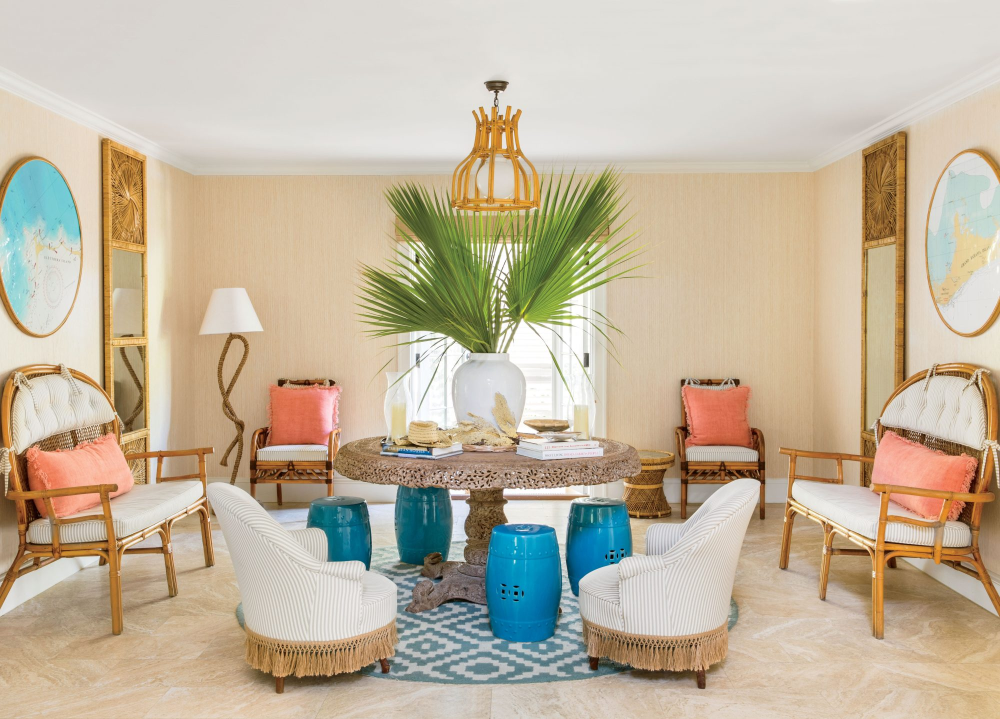 Designer Amanda Lindroth's Caribbean-classic style is exemplified in this Harbor Island, Bahamas, home, where bright color and natural textures reign supreme. In the entry, pictured here, teal garden stools provide a pop of coastal color against a neutral