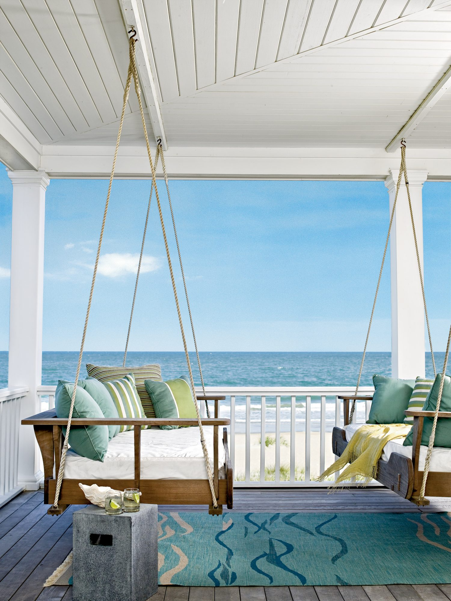 Suspend swinging daybeds on the porch of this DeBordieu, South Carolina, beach house capitalize on the stunning vie w, shade, and waterfront breezes. We recommend opting for mattresses with washable slipcovers and pillowcases in outdoor-safe fabrics. Here