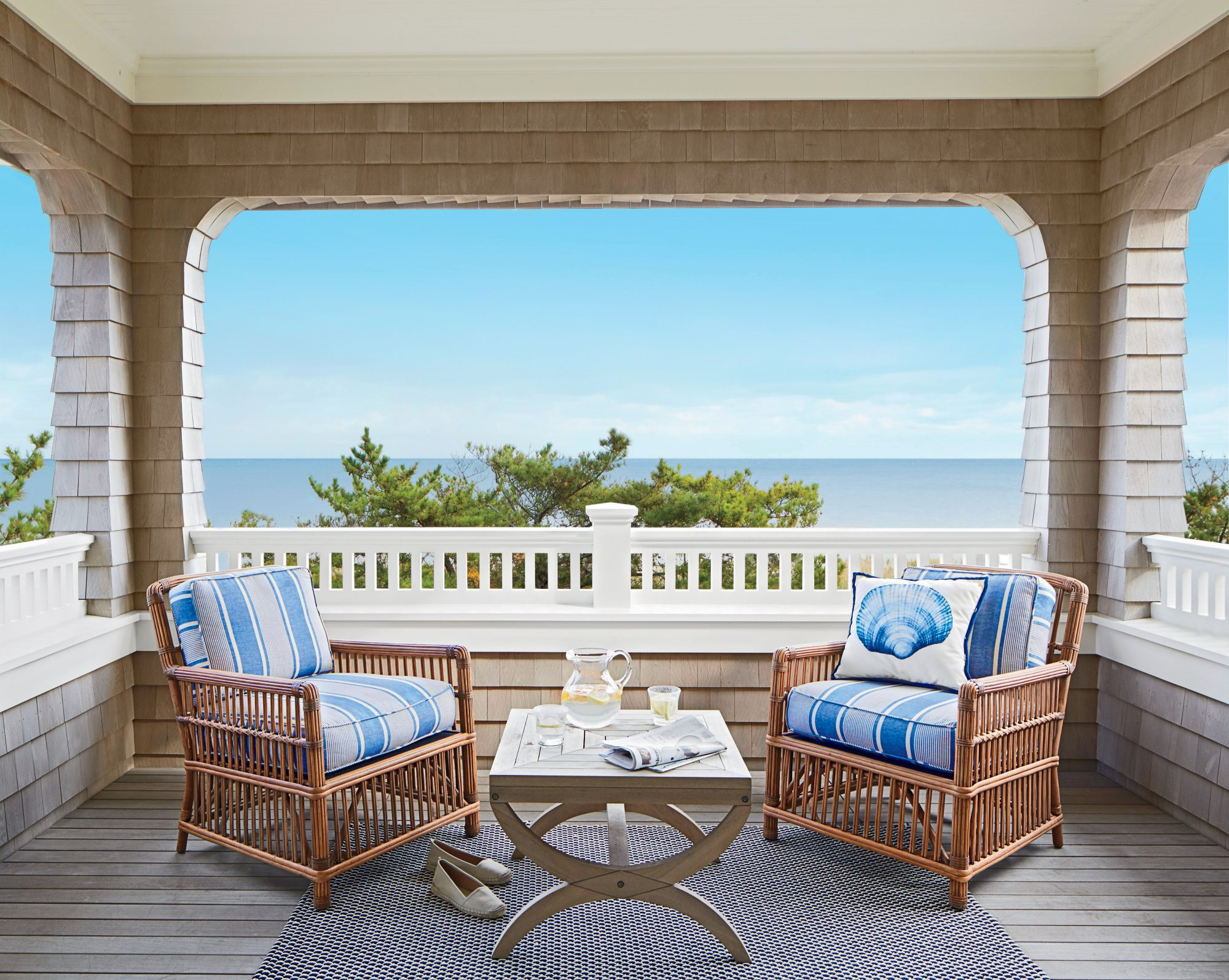 Panoramic water views, ocean-inspired décor, and classic charm are abundant on this restful Jersey Shore porch.