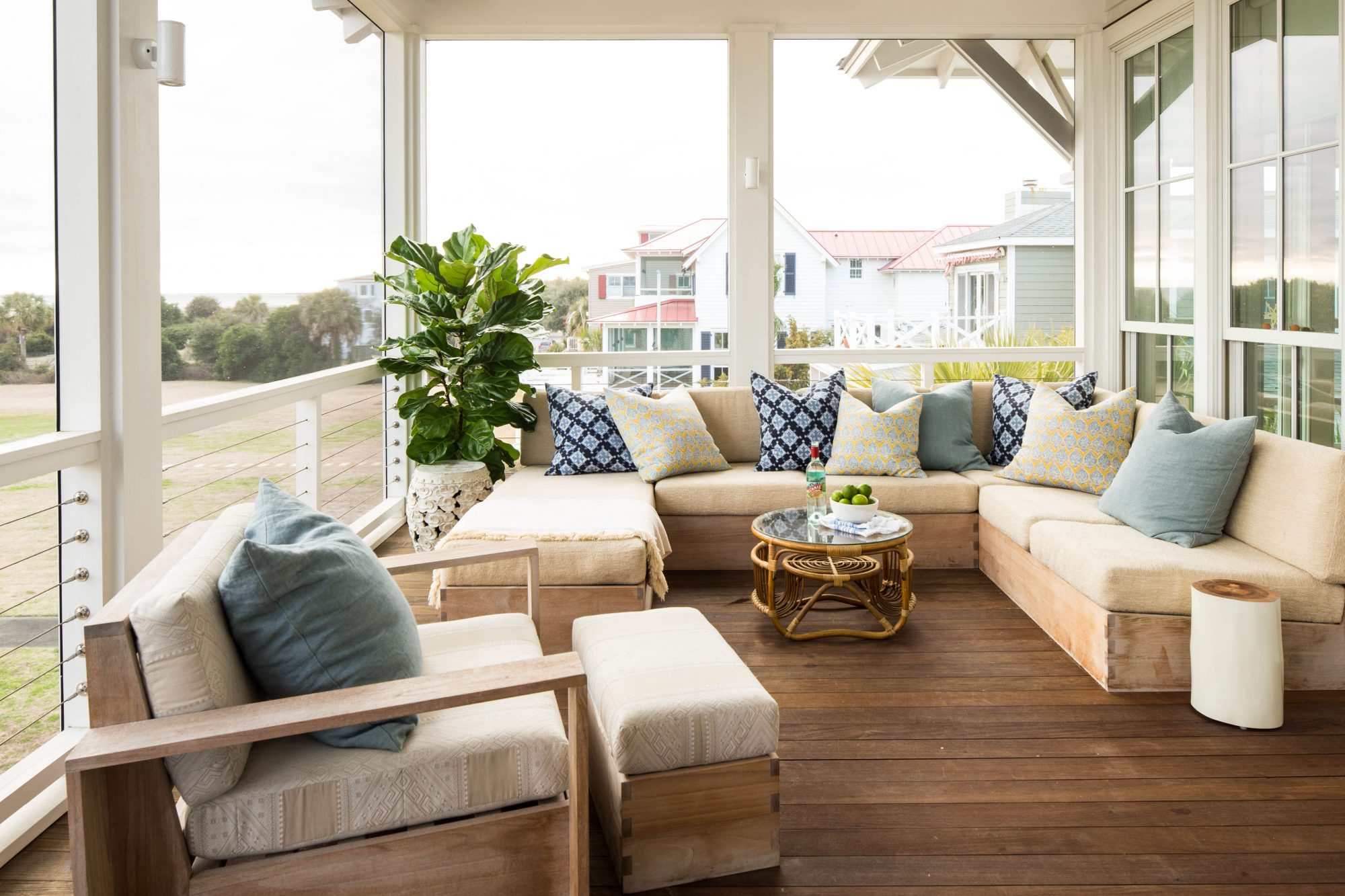 This Sullivan's Island screened porch is a favorite perch for watching boats pass in and out of nearby Charleston Harbor. A sectional sofa suited for the outdoors offers plenty of room for lounging and entertaining friends.