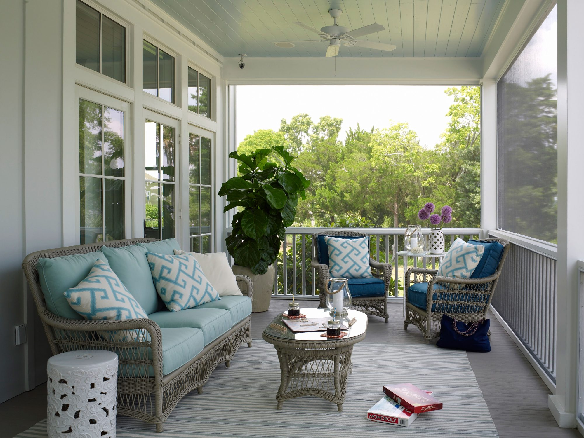 The back porch of our 2013 Showhouse in Daniel Island, South Carolina, is all about comfort and calming colors. The blue palette ranges from light to dark and is balanced by the natural-hued wicker furniture.