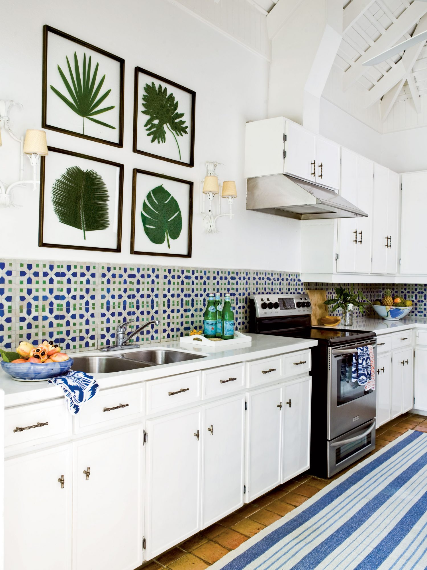 Keep the rest of the appliances and cabinetry simple to make the more decorative elements pop. Frame island fronds for an inexpensive D.I.Y. project.