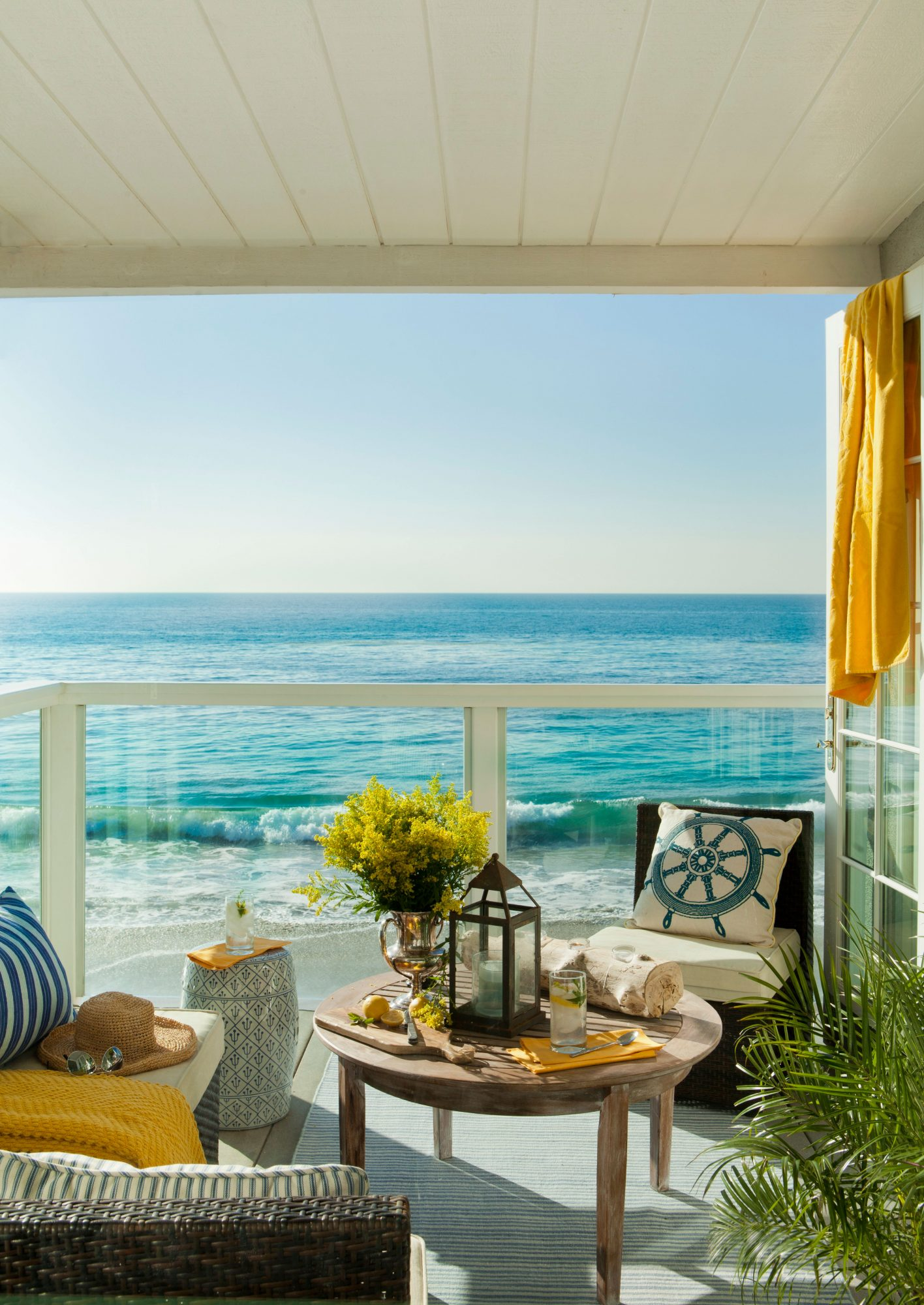With a view this stunning, glass panels are the perfect surround for this Malibu porch.