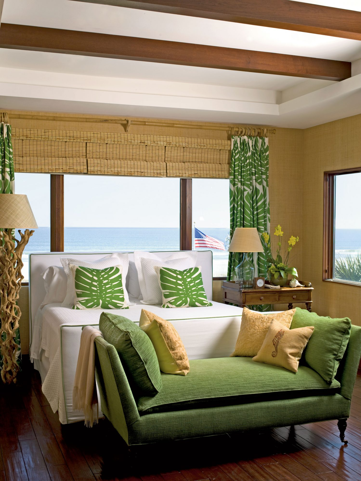 Driftwood, bamboo, and linen are echoed throughout this bedroom to add depth and dimension to the rain forest color palette.