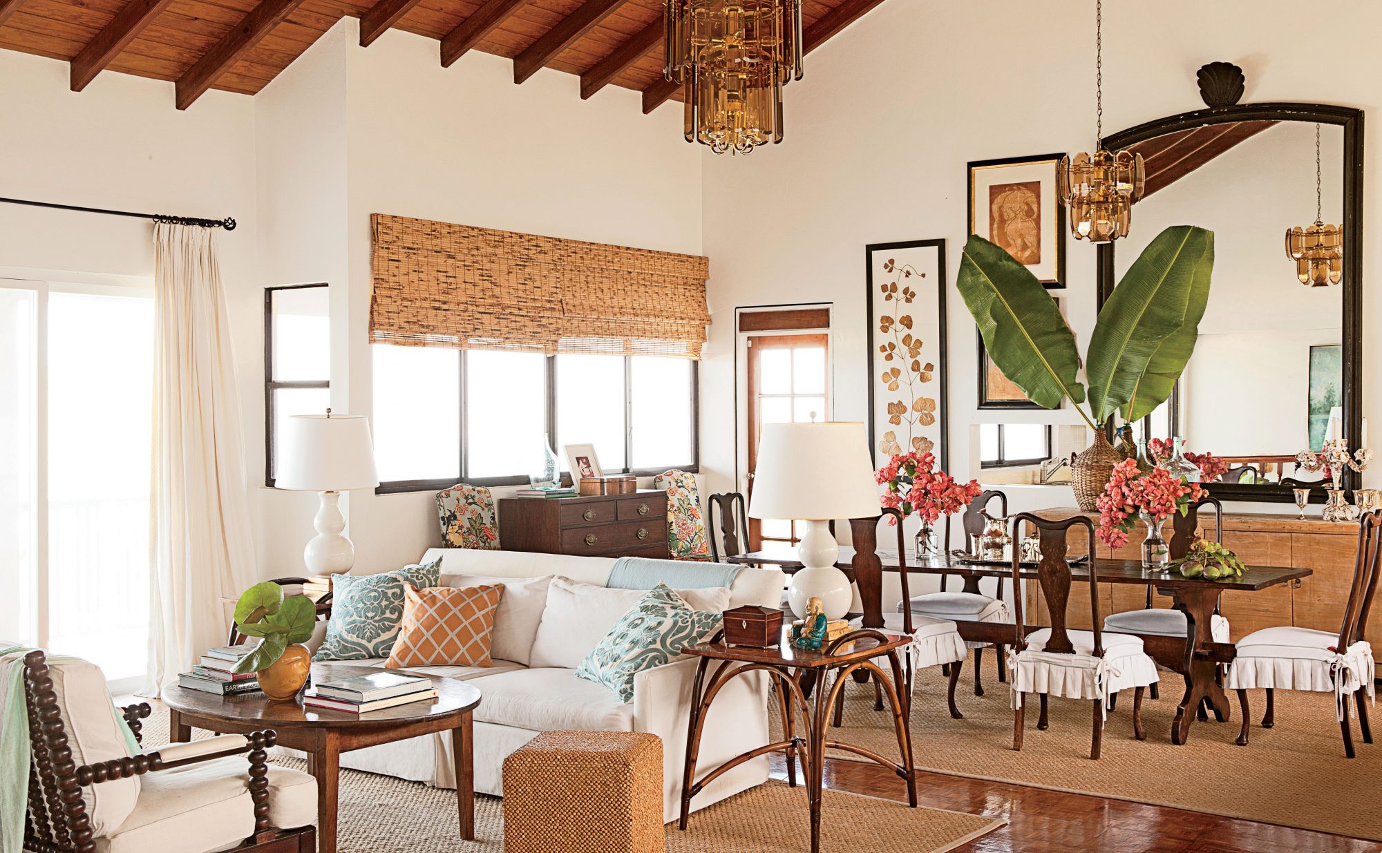 This St. Kitts great room features dark stained wood—a frequent feature of island design—but also retains an airy feeling thanks to its vaulted ceilings, creamy walls, and natural fiber rugs.