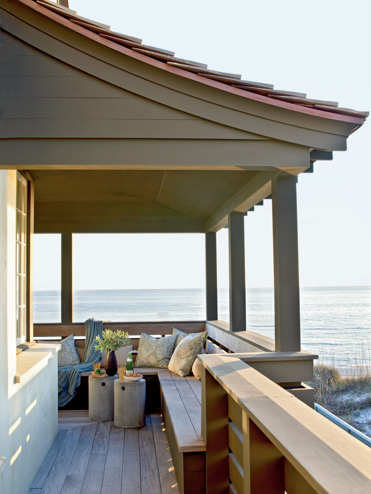 A wraparound porch ensures you'll have spectacular views. Built-in benches with plush pillows provide seating to enjoy the relaxing ocean waves.