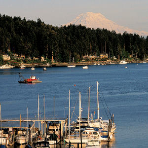 Gig Harbor, Washington                                       This Washington enclave astounds newcomers with its rare beauty and rich maritime history. Tucked into the south end of Puget Sound, Gig Harbor claims unparalleled views of Mount Rainier. The town's just an hour from downtown Seattle and a few minutes across the bridge from Tacoma.