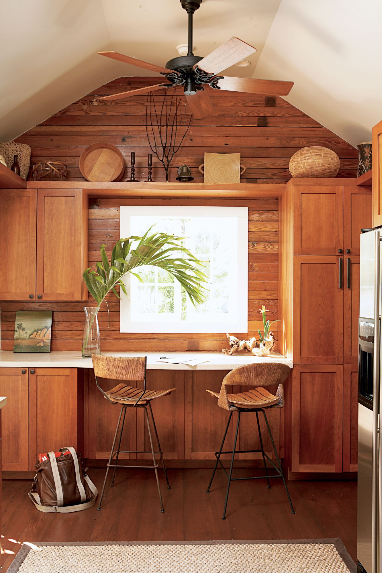 Refinished original Dade County pine, now an endangered native species, adds rich vintage warmth to a 19th-century home.