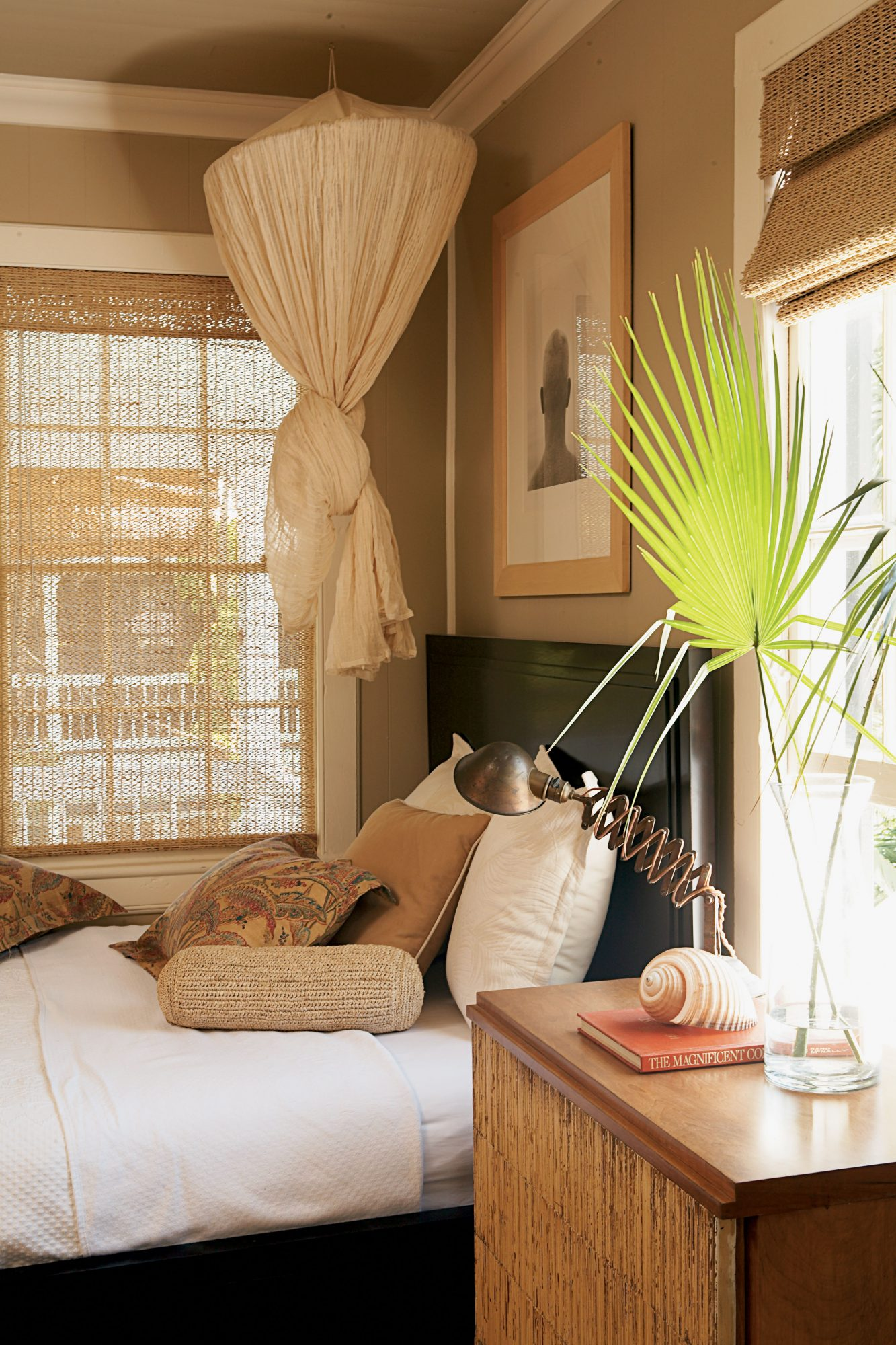 Gauzy netting can be draped over the bed to lend a dreamlike quality to this master bedroom.