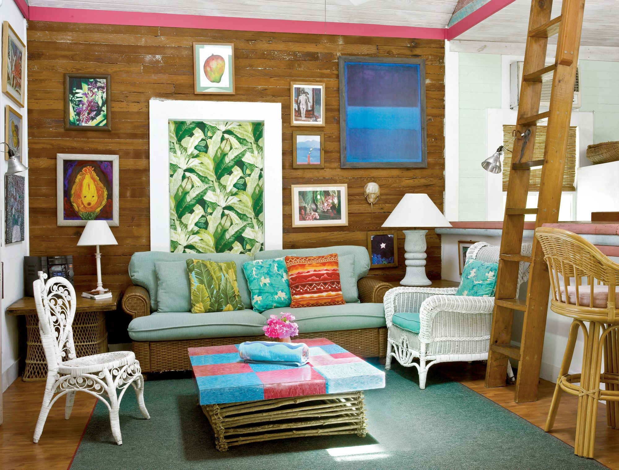 Natural pine floors, walls, and ceilings preserves the cottage's retro, lived-in look. Vintage furniture adds to the casual feel.