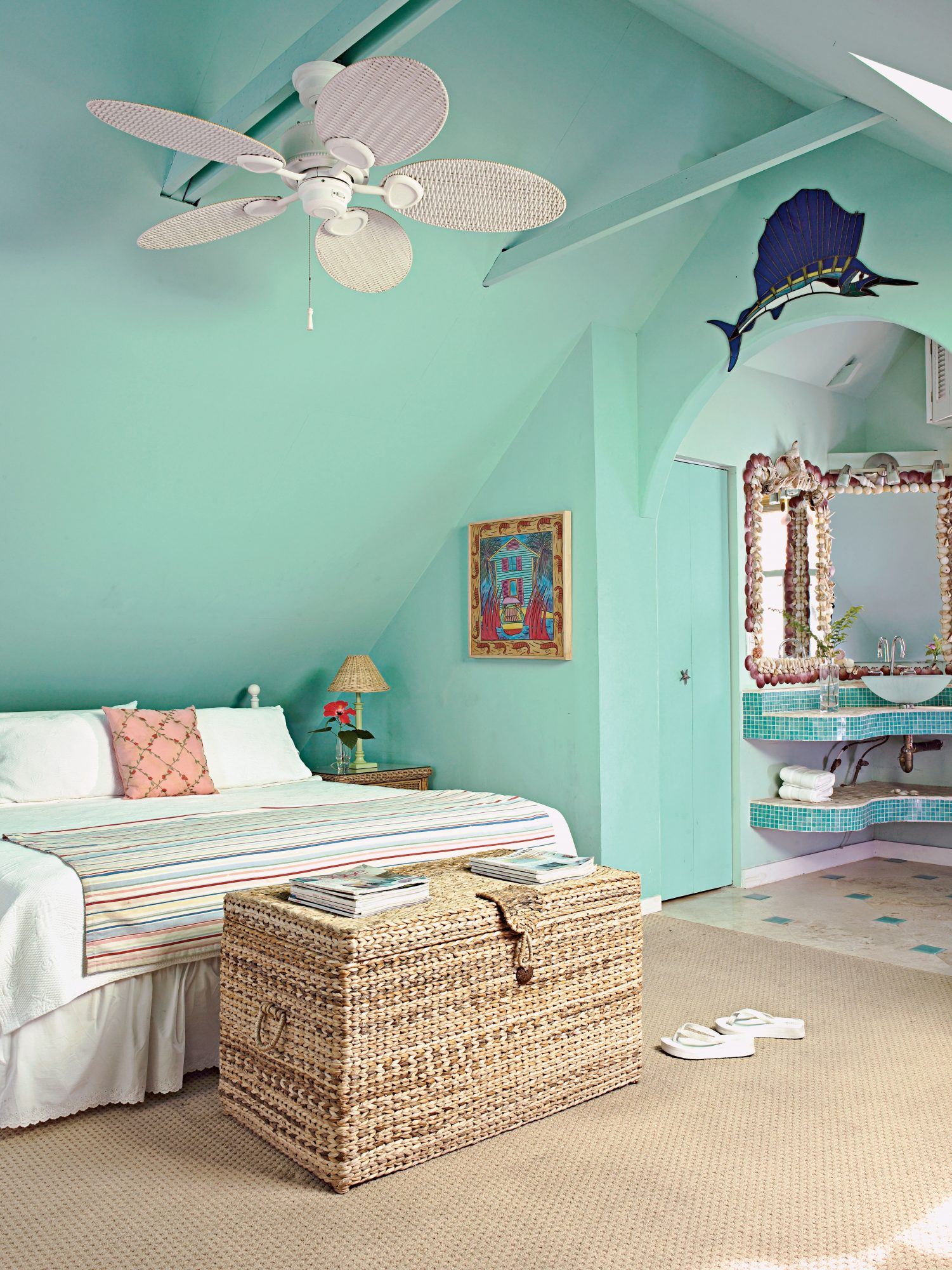 White linens pop against aqua walls in this master bedroom.