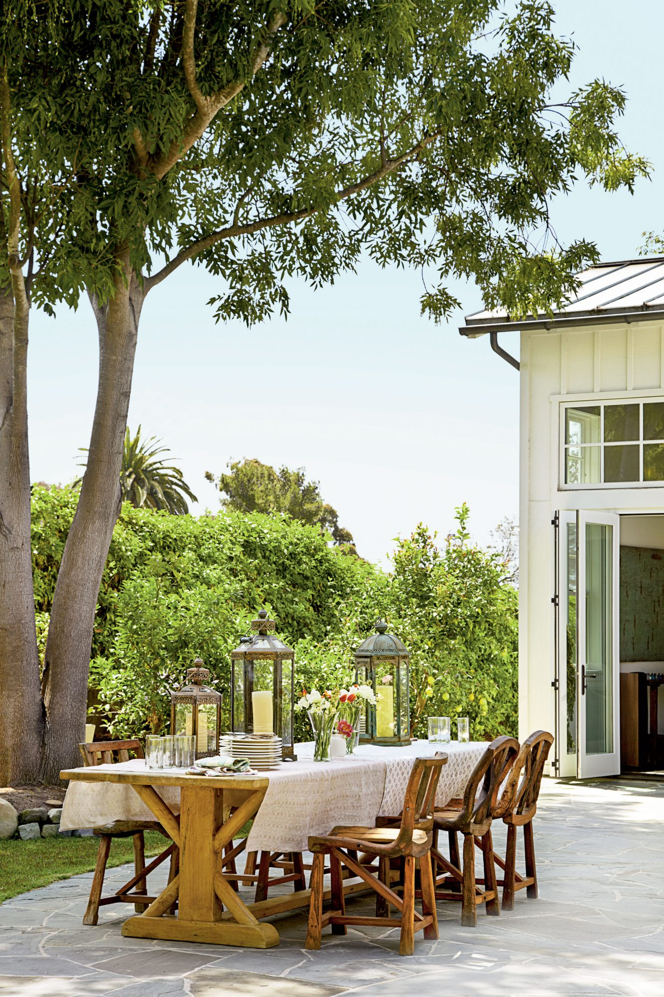 Teak furnishings and Moroccan-style lanterns make this Malibu patio perfect for dining al fresco.