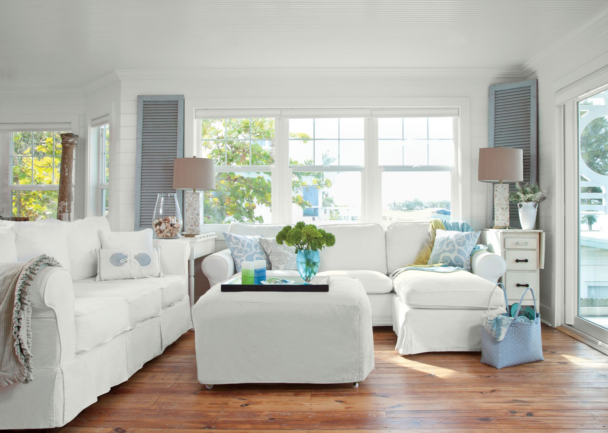 Many island homes feature exterior shutters that can be opened to take advantage of tropical breezes, or closed during rough winds, but this living room puts a fresh twist on the classic element by incorprating a painted shutter into the décor.