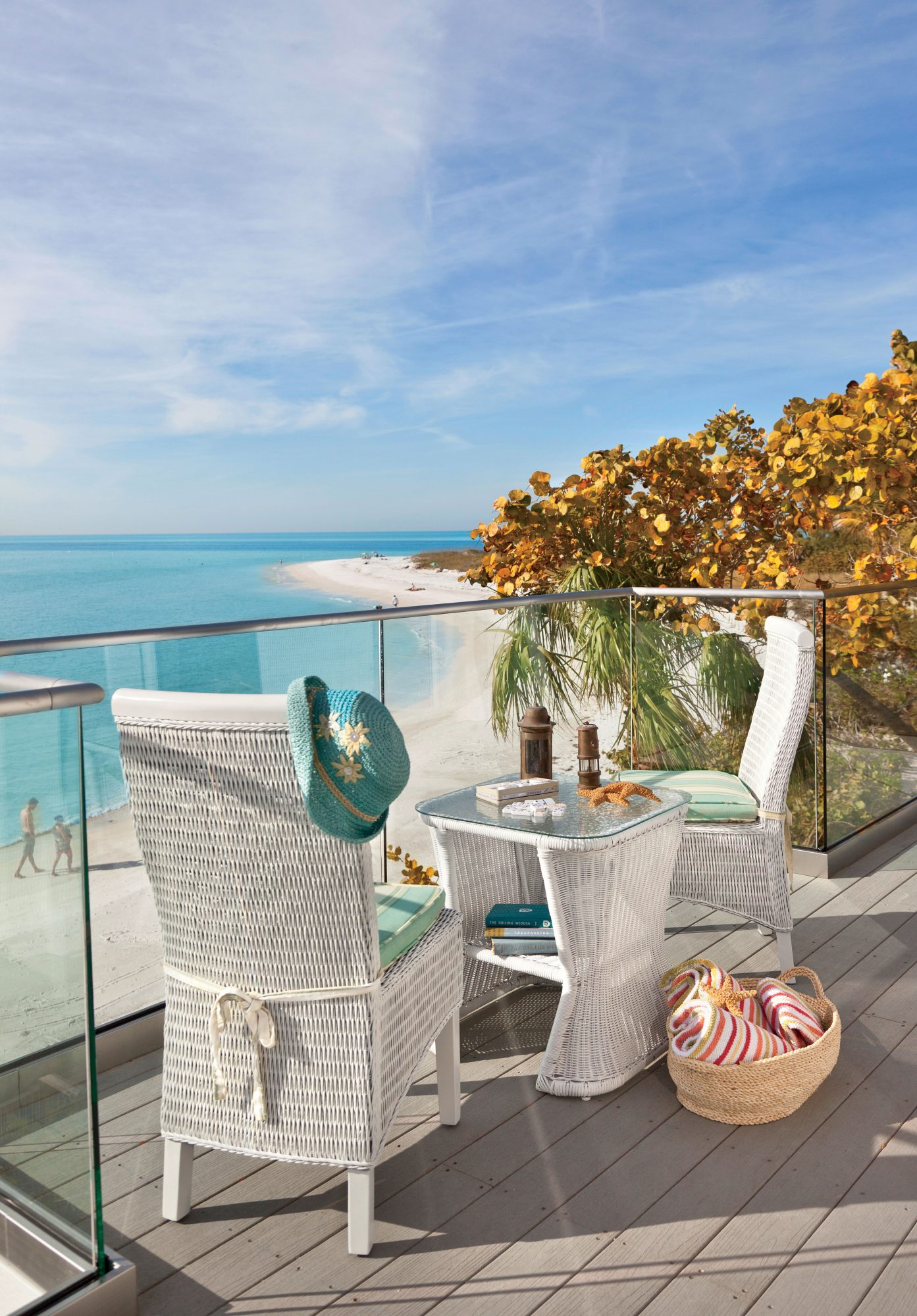 The brilliant turquoise waters of Anna Maria Island, Florida, are the star of the show on this glass-walled porch. The white wicker furnishings pop against the shoreline.