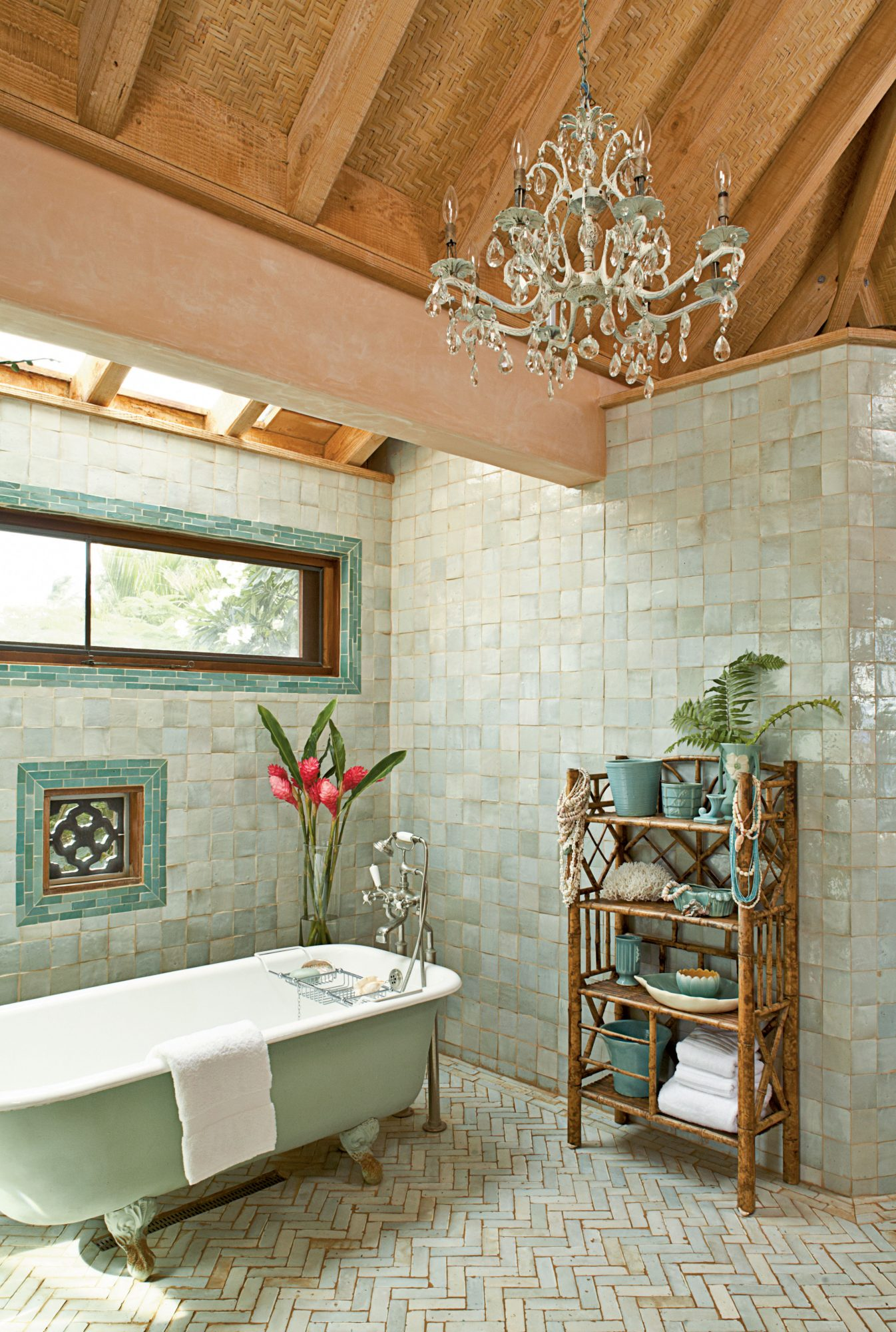 This master bathroom's shimmering Moroccan tiles are a softer take on the vibrant greenery outside and create a relaxing tone for a long soak. The light green tub—instead of a traditional white or cream—unifies the space.
