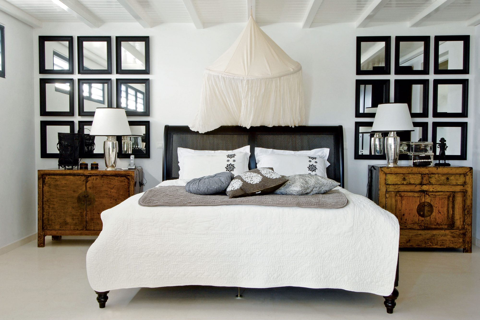 Veer away from an ultra-mod, cold look by adding antique wood pieces and a mix of soft-toned pillows to maintain the uncluttered, laid-back ease of the islands.