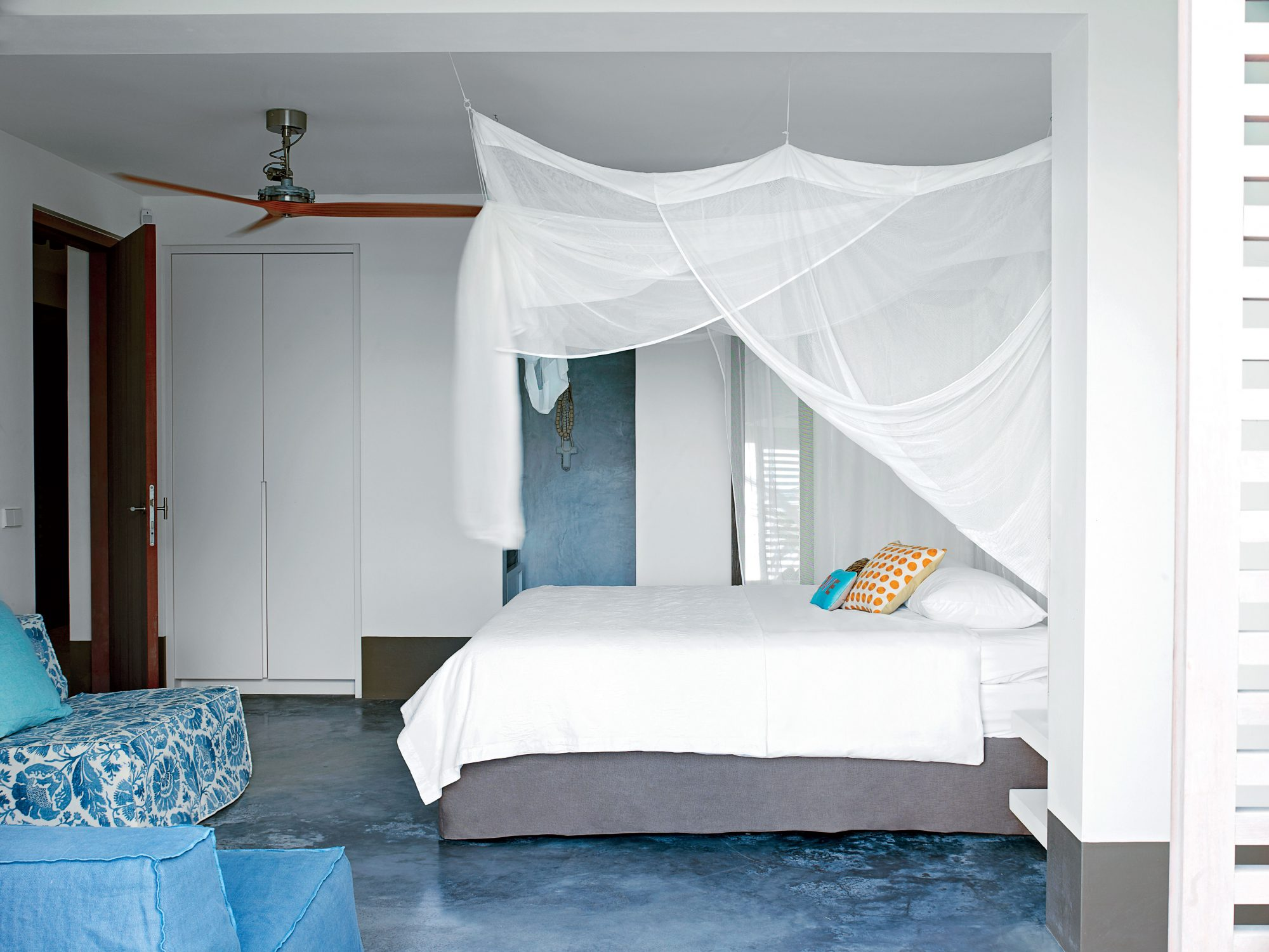 A neutral color palette and uncluttered design make this Bonaire bedroom feel like a peaceful spot for relaxation. The airy canopy lends a touch of island style without detracting from the room's modern aesthetic.