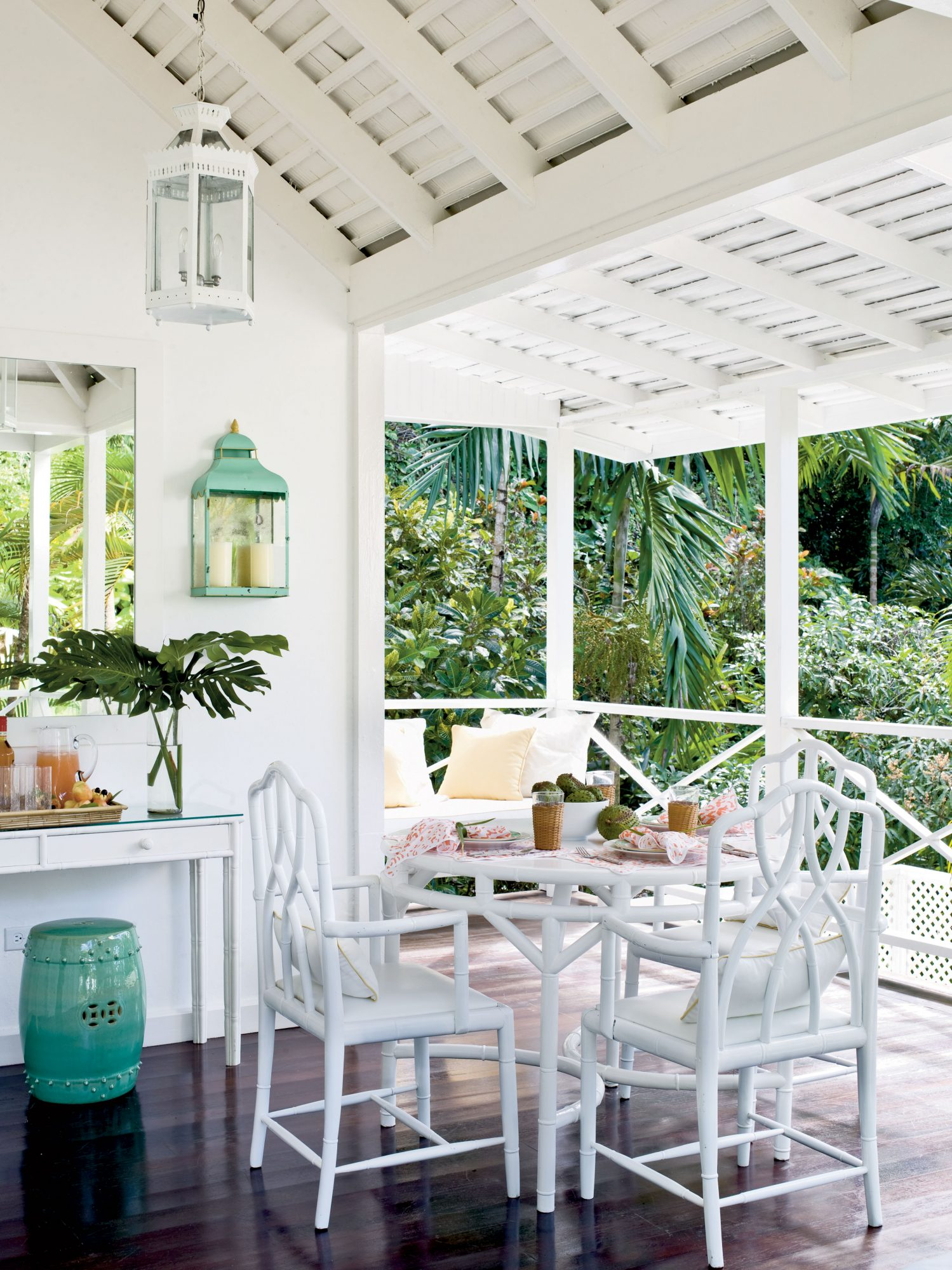 Outdoor lanterns, bamboo furniture, and a ceramic stool will stand up to the elements without sacrificing style.