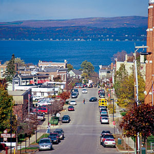 Petoskey, Michigan                             Between the tourist frenzy of Traverse City and the polished club-iness of Harbor Springs, the casual town of Petoskey has its own identity on the northeast coast of Lake Michigan. The vibrant downtown is compact and fueled largely by summer visitors, but the steep streets, historic architecture, and miles of waterfront make it a great place to settle year-round.