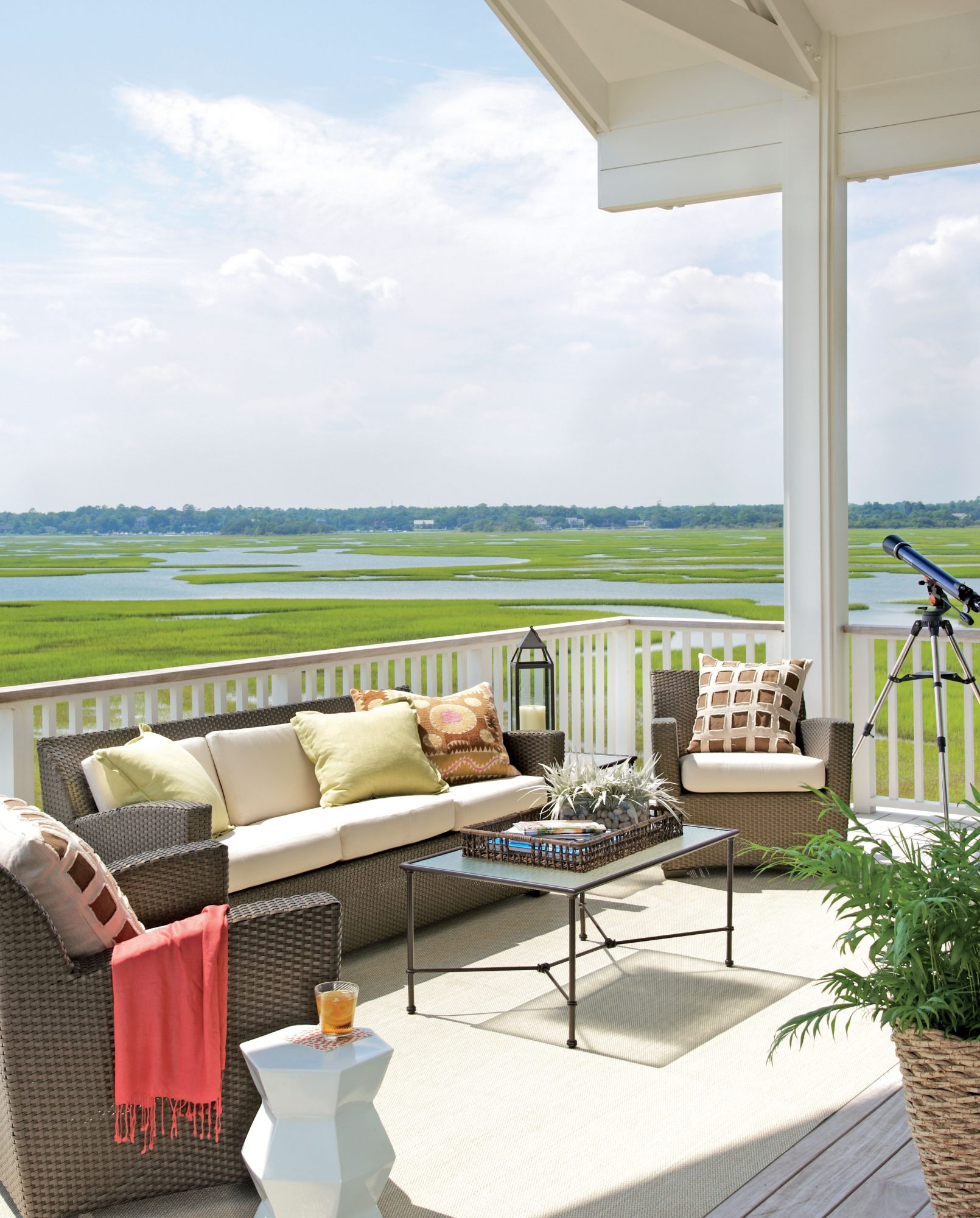This classic-meets-contemporary deck on Figure Eight Island, North Carolina, is the perfect place for the homeowners to enjoy the salt air and inspiring sunsets. The seating is from Brown Jordan's Fusion Collection.