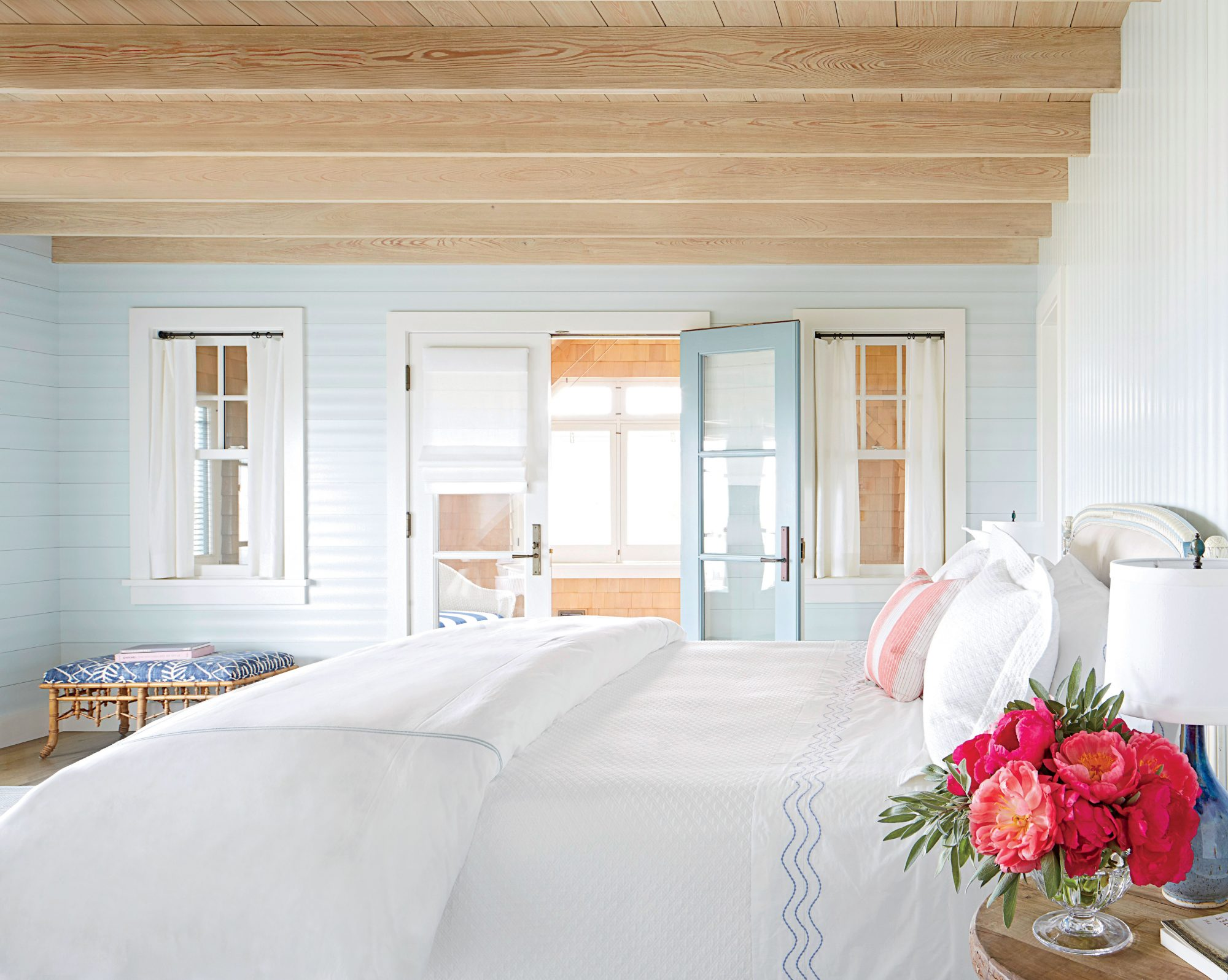 Cypress ceilings and shiplap walls painted soft seafoam lend a breezy feel to this Jersey Shore bedroom.