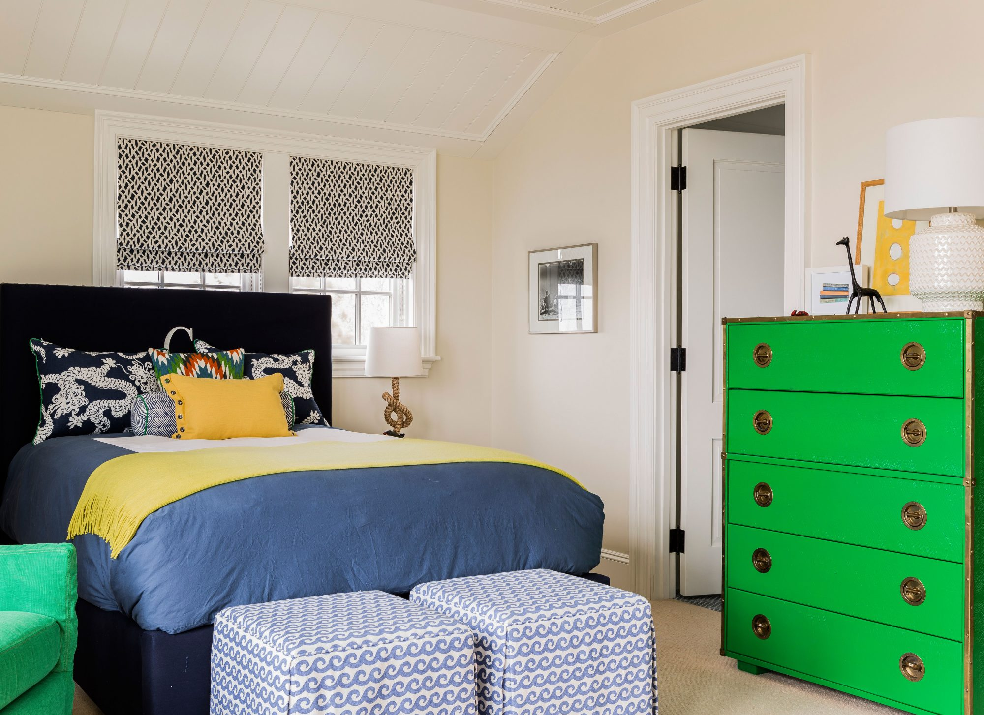 A vintage kelly green campaign dresser plays well with varying shades of blue and bright yellow in this Cohasset, Massachusetts, beach house.