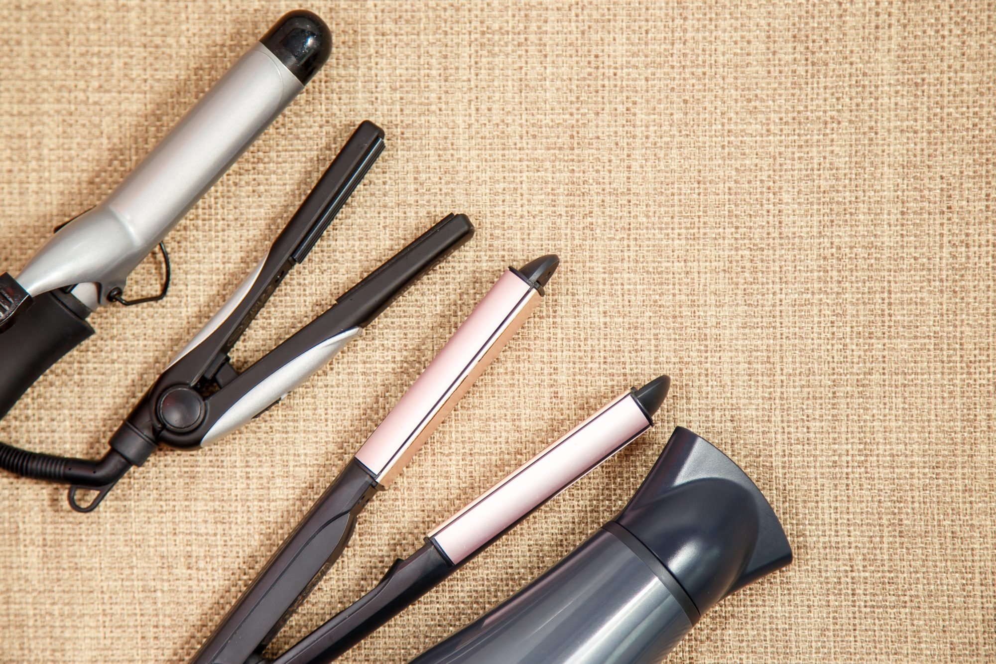 Collection of the professional hairdresser appliances - hair dryer, curling, corrugation, straightener top view