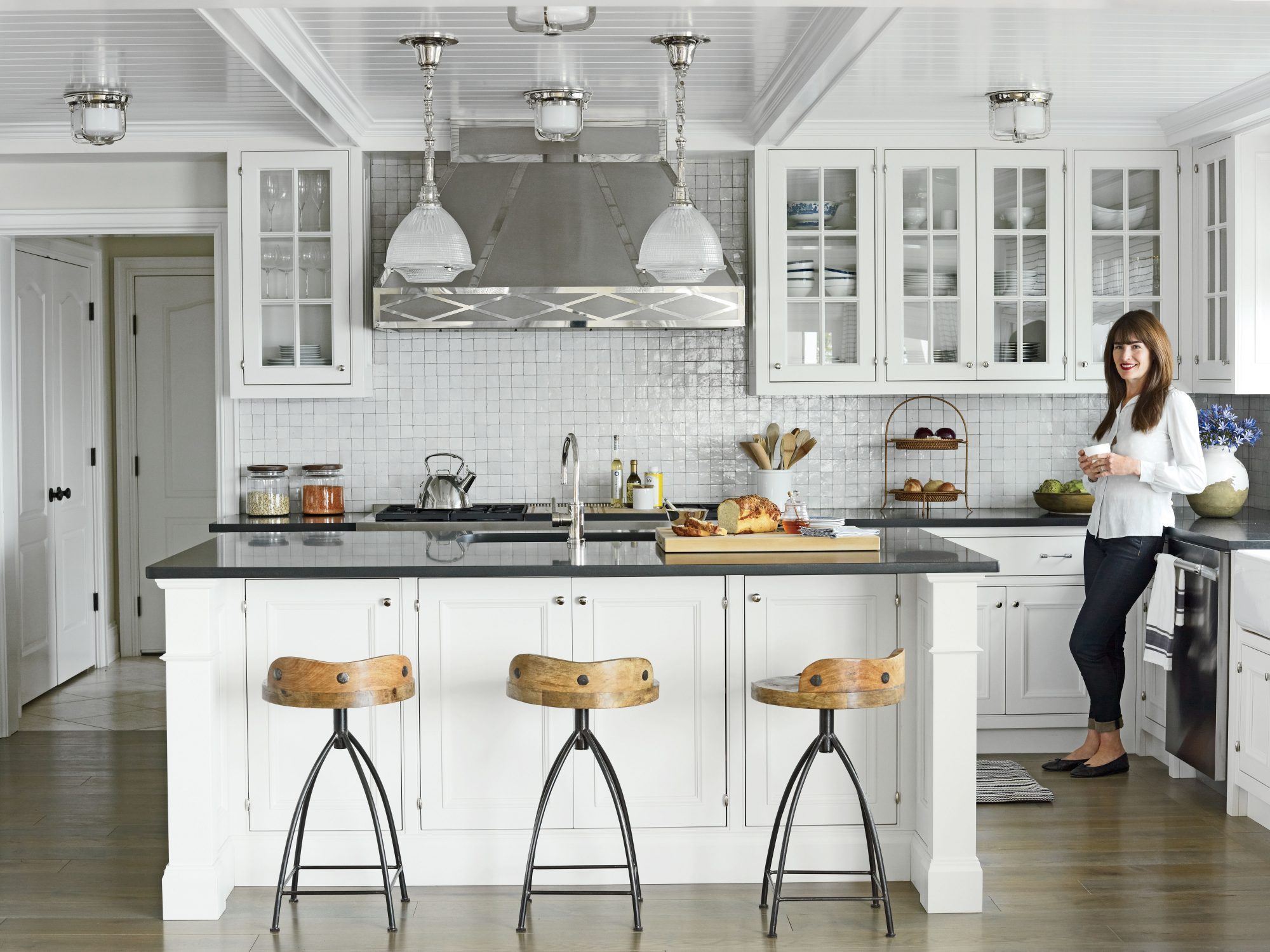 With its new, Shaker-style cabinetry on olive knuckle hinges, open shelving displaying pretty blue-and-white dishware, dazzling glazed terra-cotta backsplash, custom hardware made from a mold of an antique pull, and fanciful range hood, the kitchen is thi