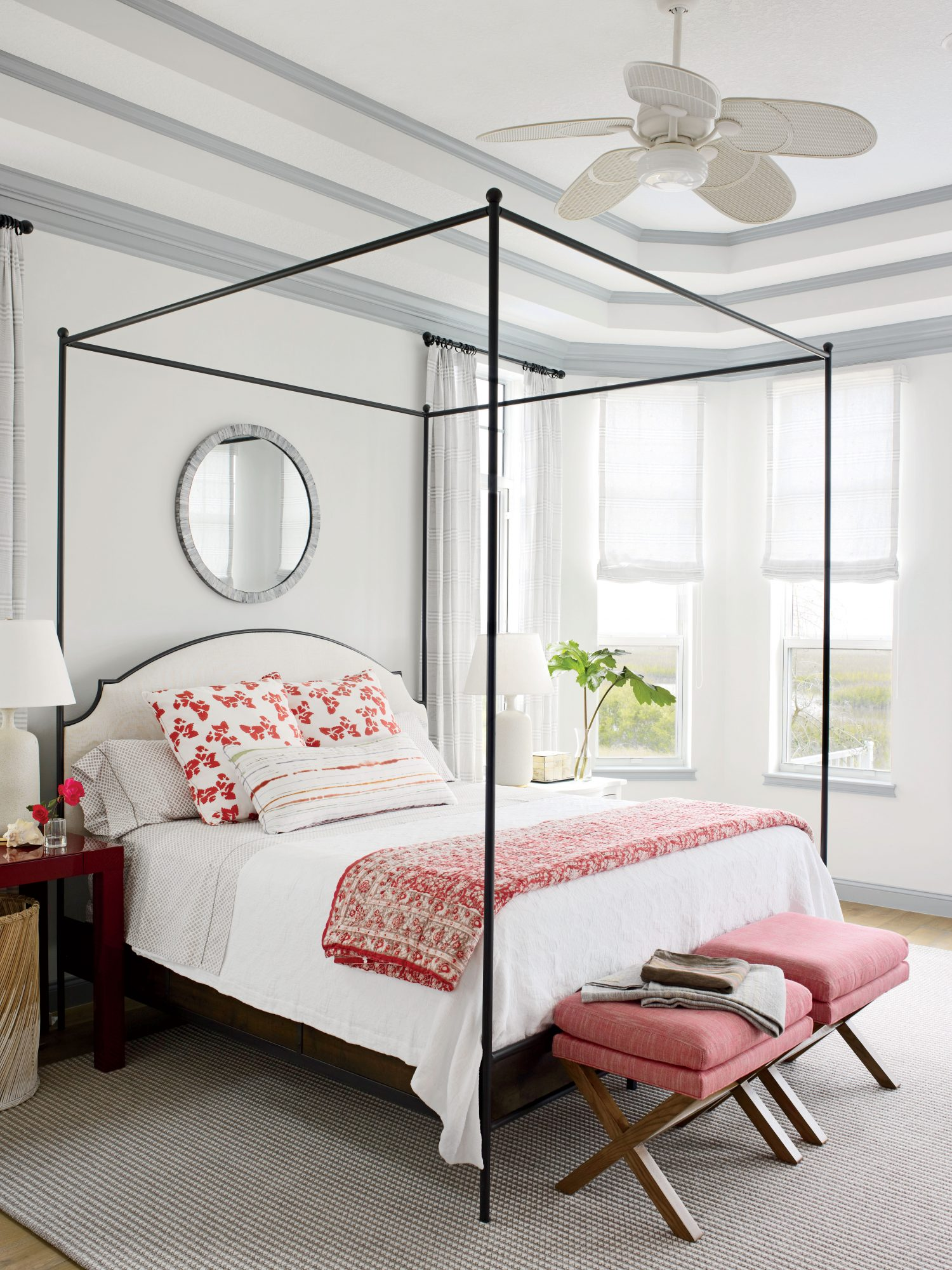 This St. Augustine, Florida, master bedroom is the picture of romance with its wrought iron canopy bed and pomegranate accents.
