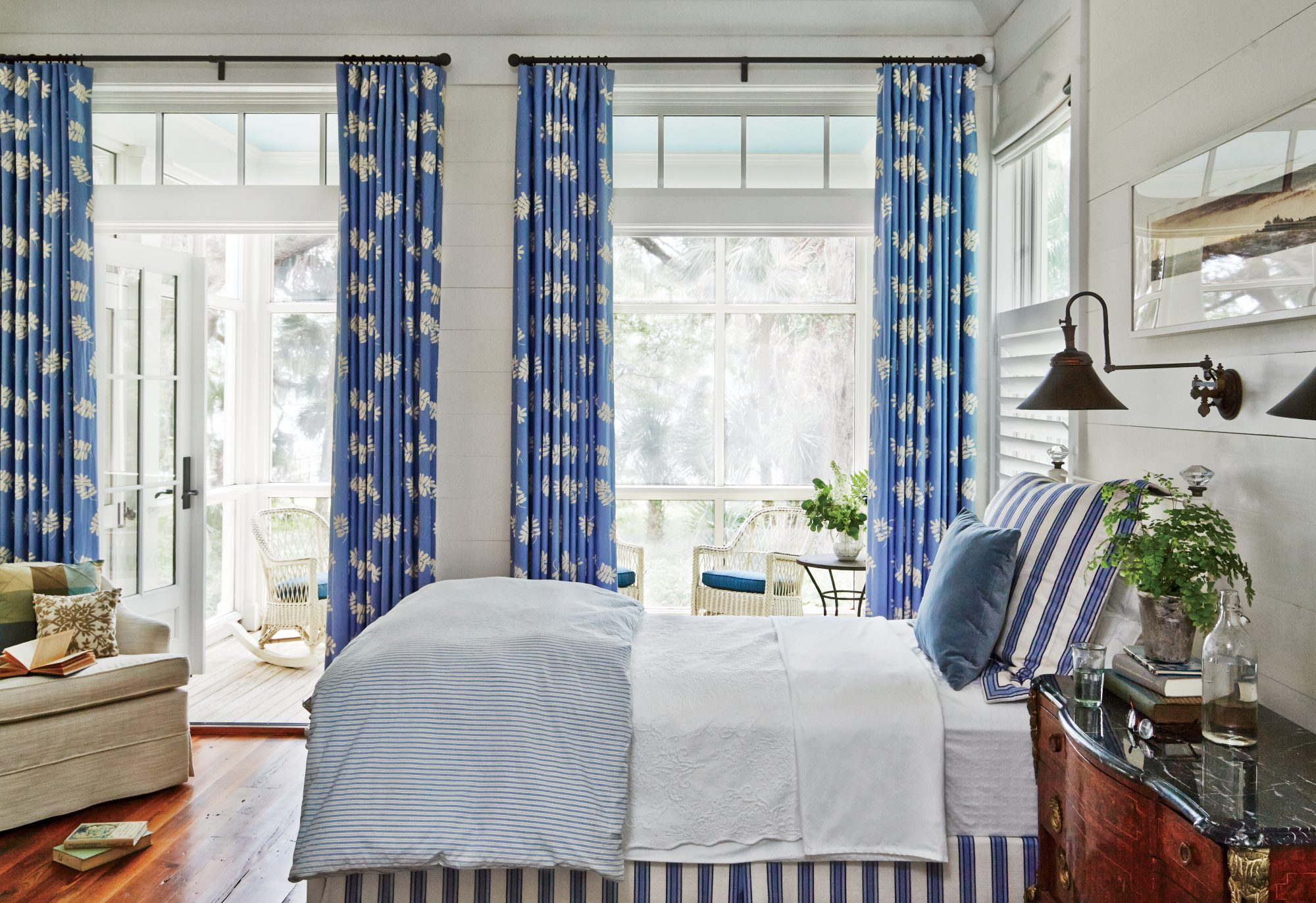 This Lowcountry bunkhouse bedroom is all about classic elements (reclaimed wood floors, large windows, and shiplap walls) and shades.