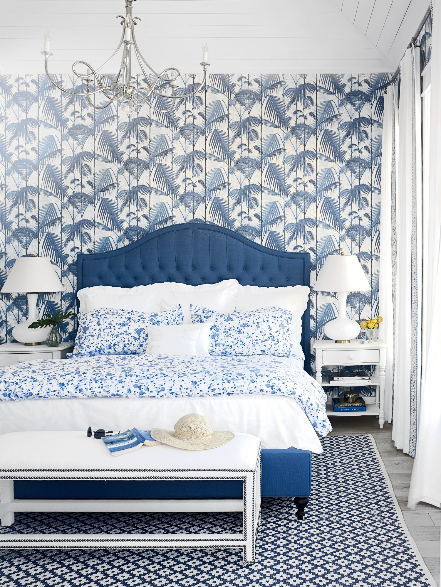 Designer Bailey McCarthy creates a striking, monochromatic look in our Cinnamon Shore Showhouse master bedroom. Using this many patterns—on the palm frond wallpaper, printed bedding, and geometric rug—could feel busy, but thanks to their shared ocean-goin