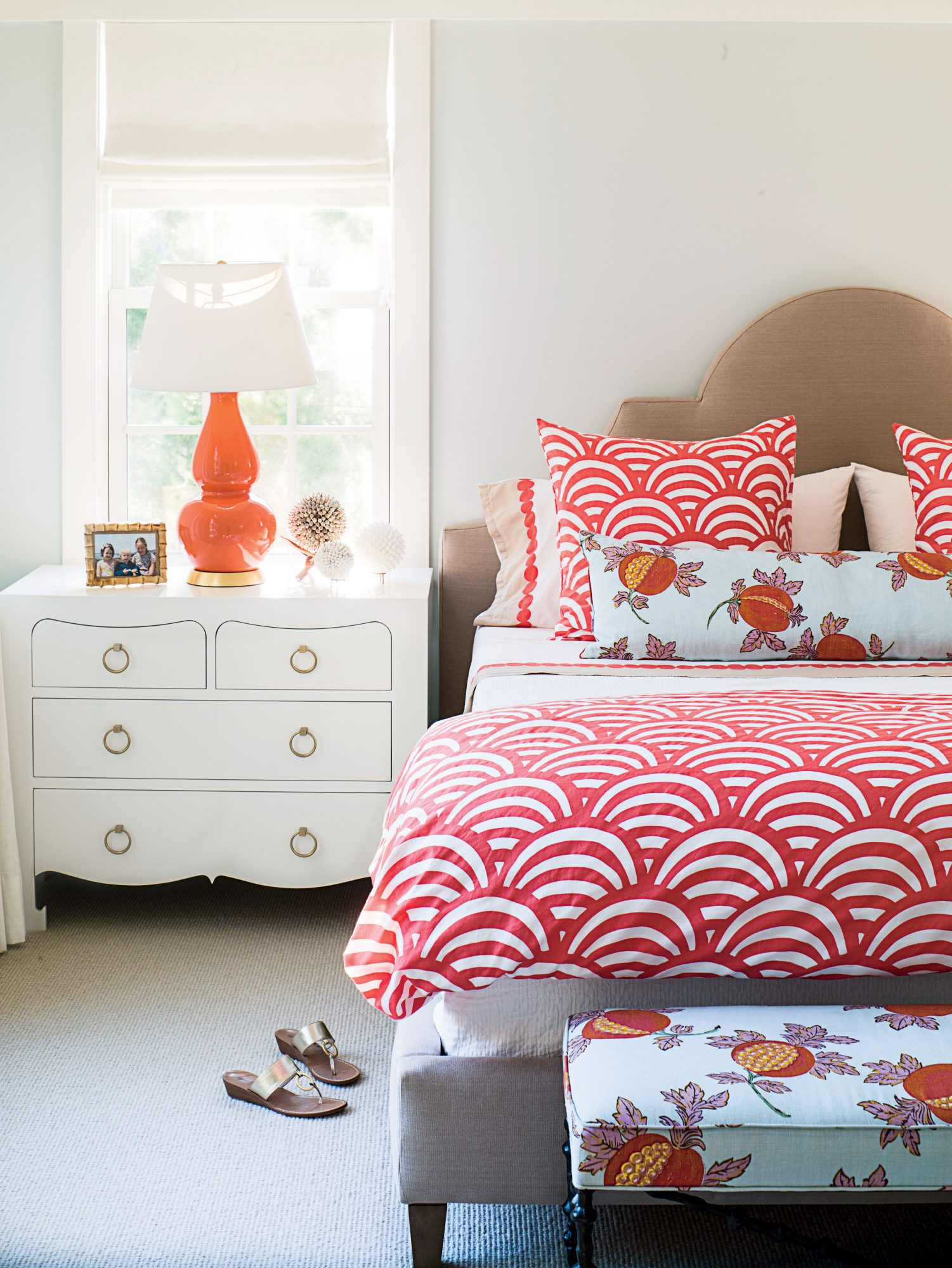 This Rehoboth, Delaware, bedroom is the perfect combination of restful and rejuvenating, thanks to its soothing neutrals, fiery color palette, and ebullient patterns.