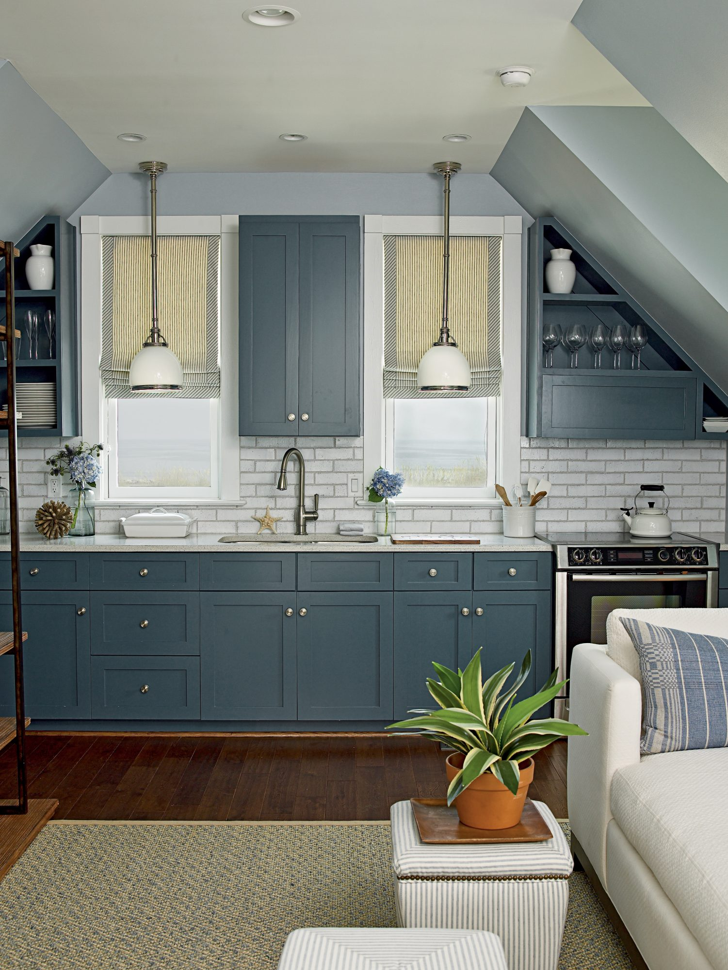 This galley kitchen (in the carriage house of our 2011 Showhouse in Norfolk, Virginia) is the epitome of small but mighty. With its rich navy cabinets and bright subway tile backsplash, it's also one heck of a looker. Plain-Jane cabinetry gets a luxuriou