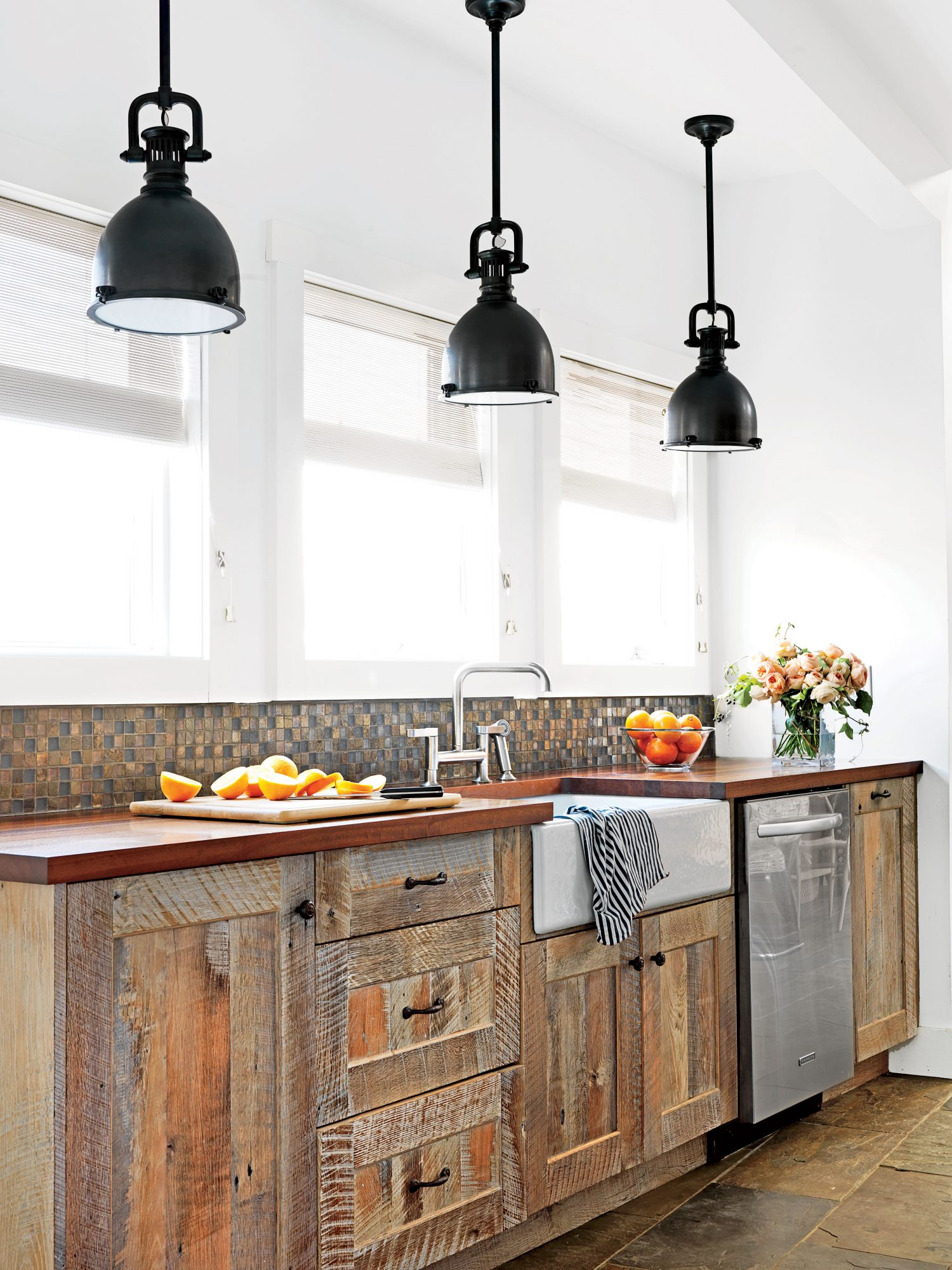 Reclaimed oak cabinets and a farm sink give this Long Beach Island, New Jersey, kitchen a laidback feel.