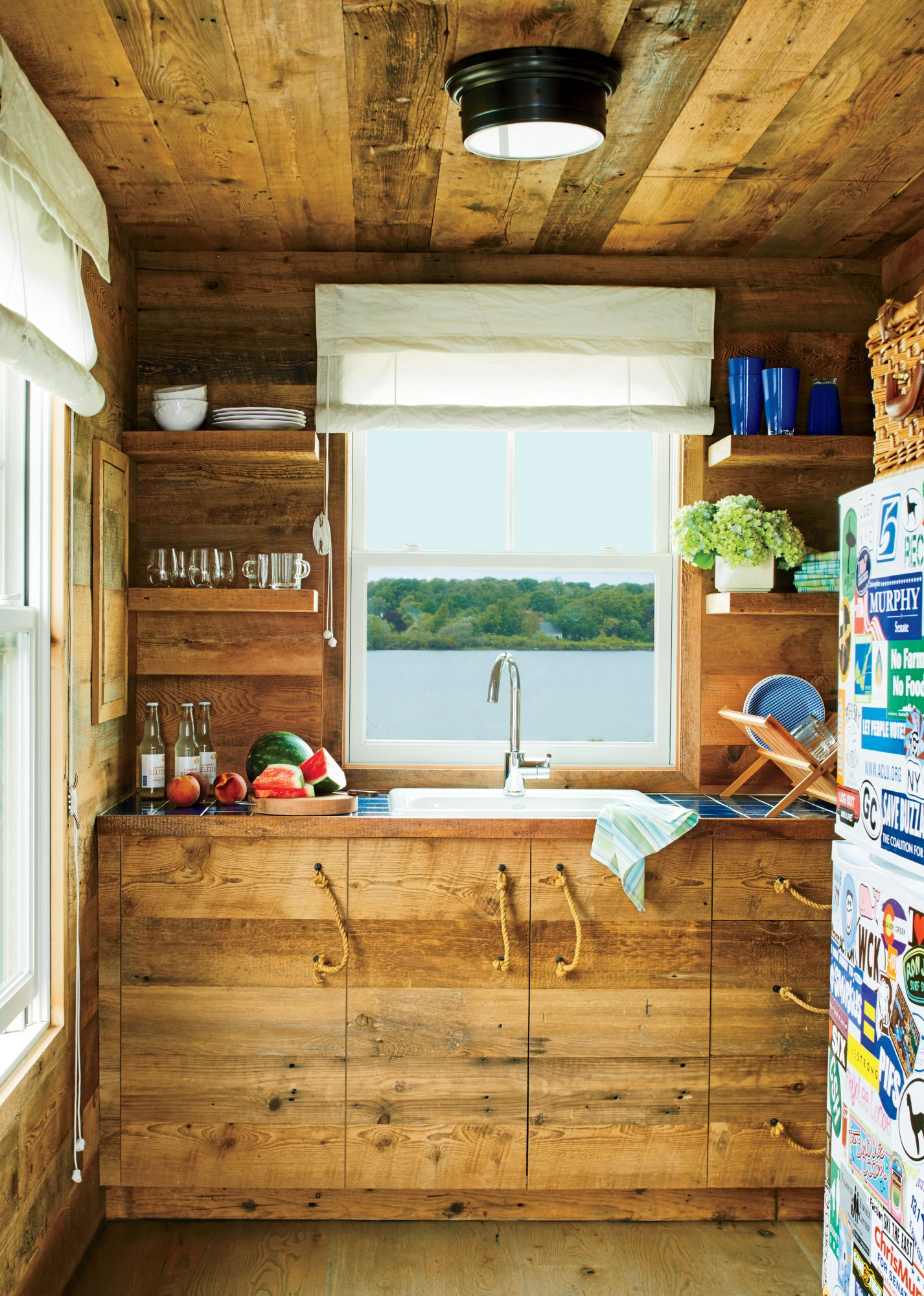 Nautical elements, such as the handsome rope pulls and the sailcloth shades, give this tiny Cape Cod cottage kitchen plenty of personality.