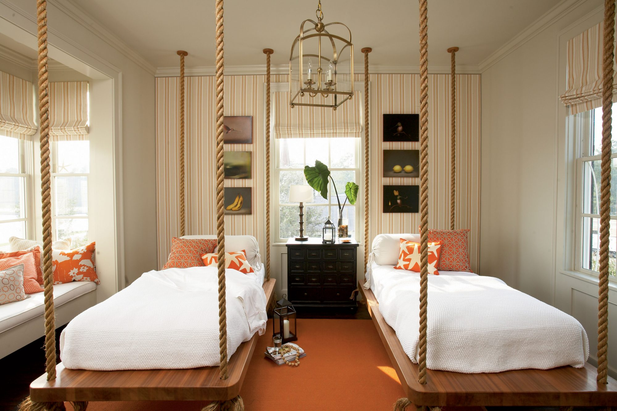twin beds suspend in space with ropes in this nautical beach bedroom