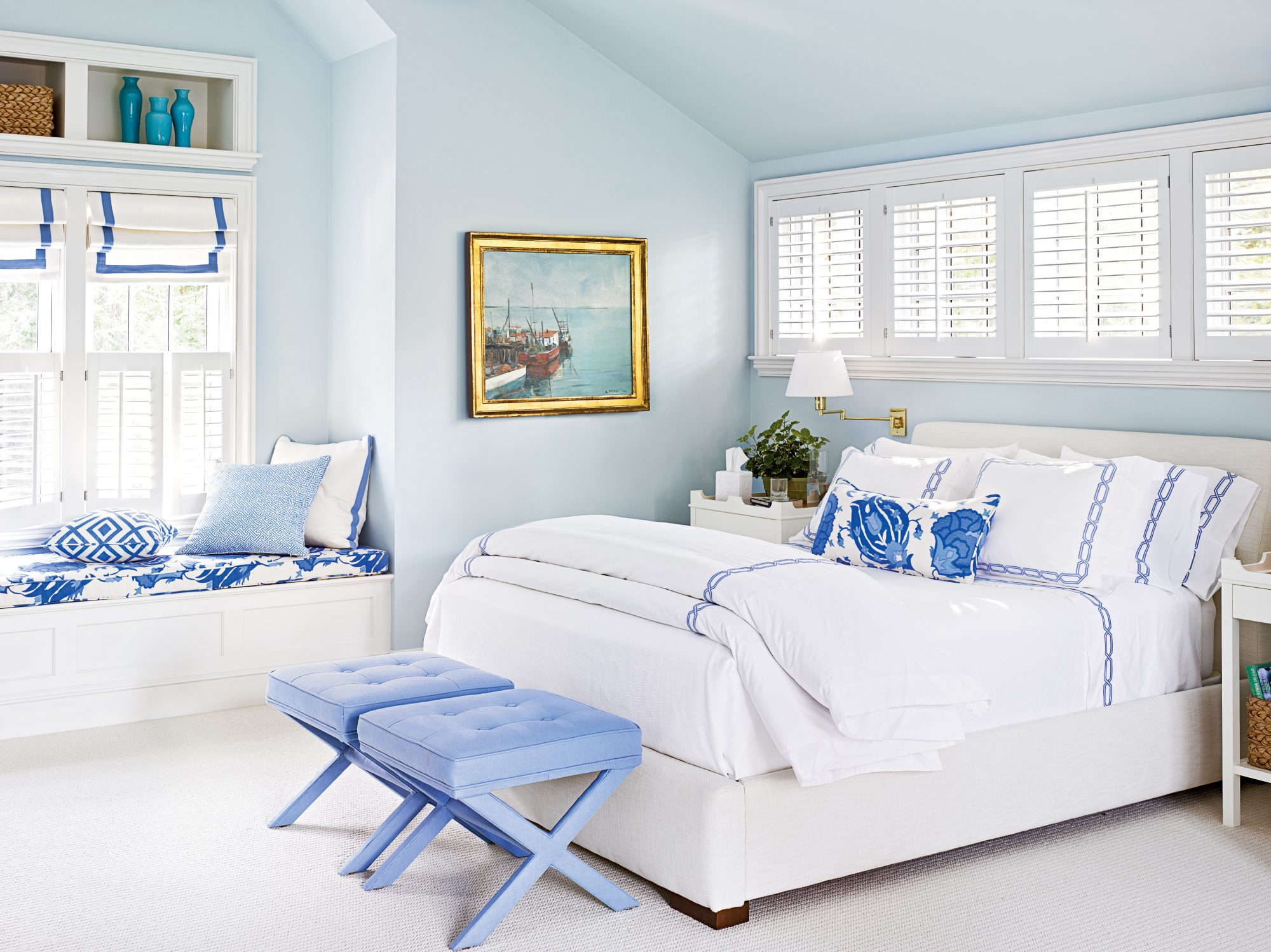 In the master bedroom of this Manchester-by-the-Sea, Massachusetts, beach house, designer Lynn Morgan set a soothing mood with a monochromatic palette of soft blues. The walls are pale aqua (painted Benjamin Moore's Sweet Bluette), while the fabrics,