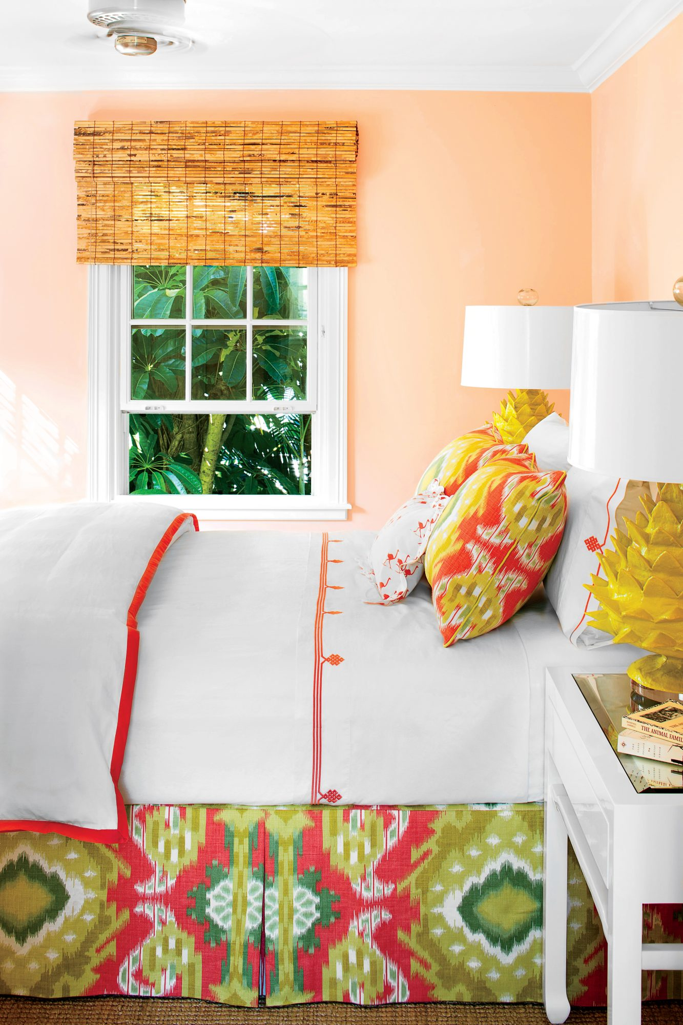 Vibrant colors come with the territory here in Palm Beach, and this guest room, with its hot pink, lime green, and mustard yellow scheme (the bed skirt and shams are in Schumacher fabric, and the duvet and sheets are from Serena & Lily) is a color lover's