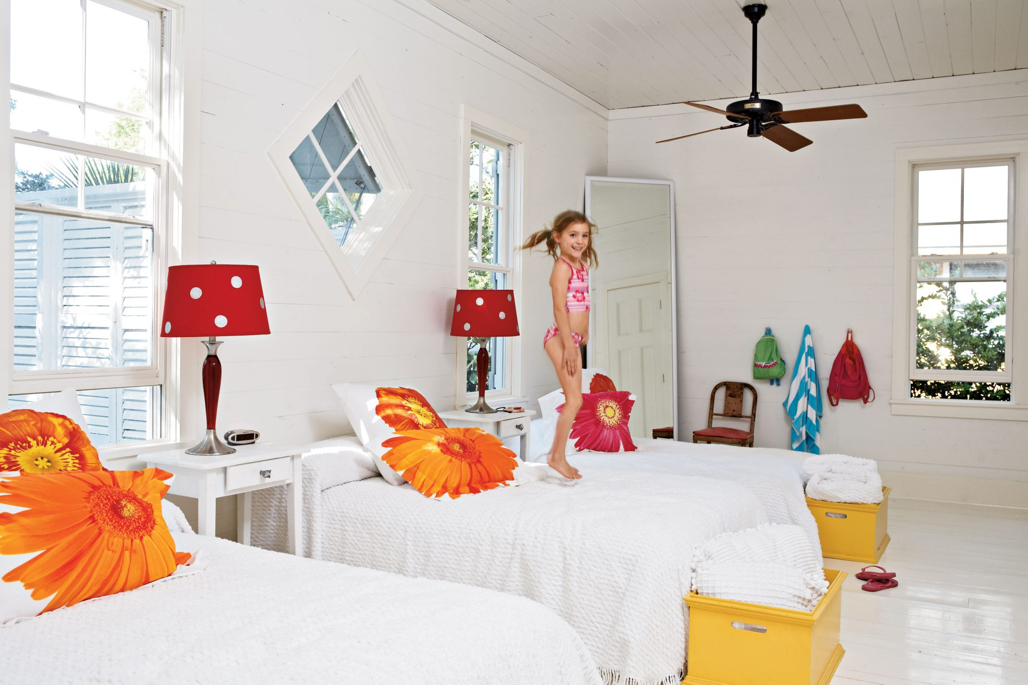 bright colored cubes at the end of the twin beds store kids' sleepover items